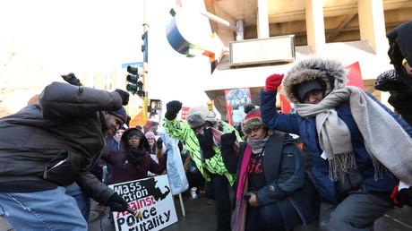 Protesters take a knee in Minneapolis, Minnesota, U.S., February 4, 2018. © Matt Blewett