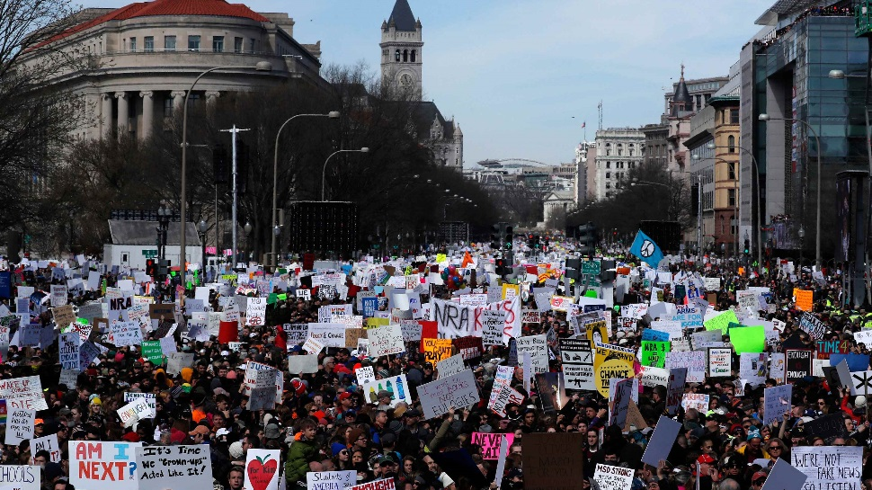 Massive crowds rally across US to urge tighter gun controls