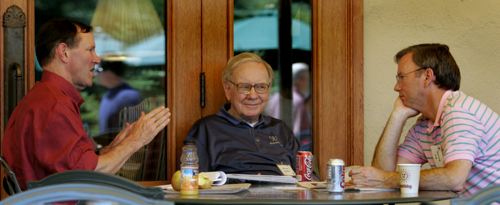 The Washington Post's Don Graham, left, Berkshire Hathaway's Warren Buffett and Google's Eric Schmidt, right, chat during the annual Allen and Co.'s conference, July 7, 2005, in Sun Valley, Idaho. (AP/Douglas C. Pizac)
