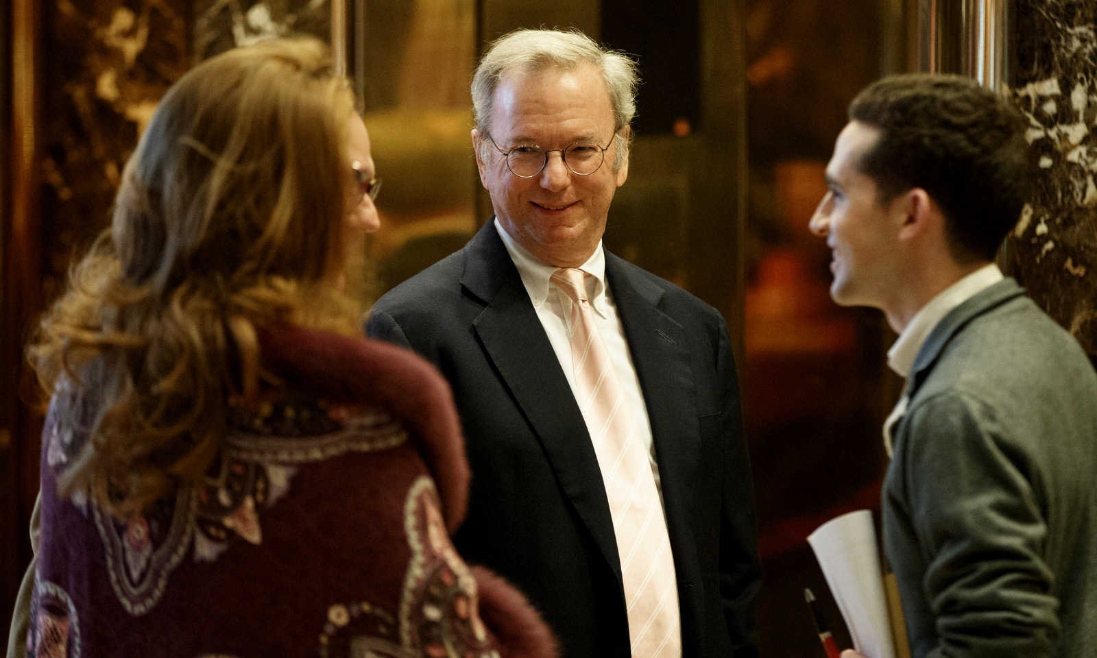 Eric Schmidt, executive chairman of Alphabet, Inc., stands in the lobby of Trump Tower in New York, Jan. 12, 2017. (AP/Evan Vucci)