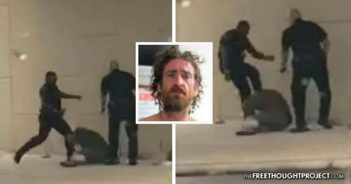 Residents Outraged As Video Shows Cops Hold Homeless Man Down, Savagely Beat Him