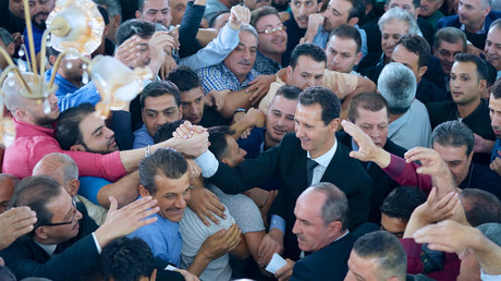 Syria's President Bashar al-Assad greets his supporters during Eid al-Adha prayers on September 1, 2017, Syria. © SANA