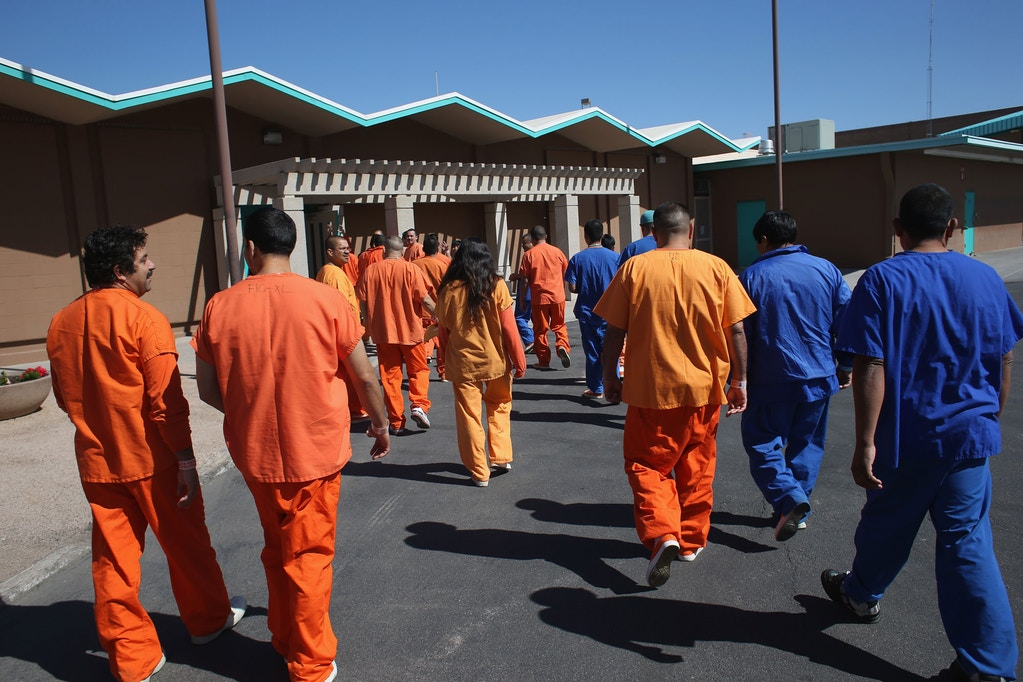 FLORENCE, AZ - FEBRUARY 28:  Immigrant detainees walk through the Immigration and Customs Enforcement (ICE), detention facility on February 28, 2013 in Florence, Arizona. With the possibility of federal budget sequestration, ICE released 303 immigration detainees in the last week from detention facilities throught Arizona. Most detainees typically remain in custody for several weeks before they are deported to their home country, while others remain for longer periods while their immigration cases work through the courts.  (Photo by John Moore/Getty Images)