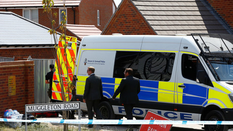 Police investigators arrive at a housing estate on Muggleton Road, after Amesbury poisoning was confirmed on July 6, 2018. © Henry Nicholls