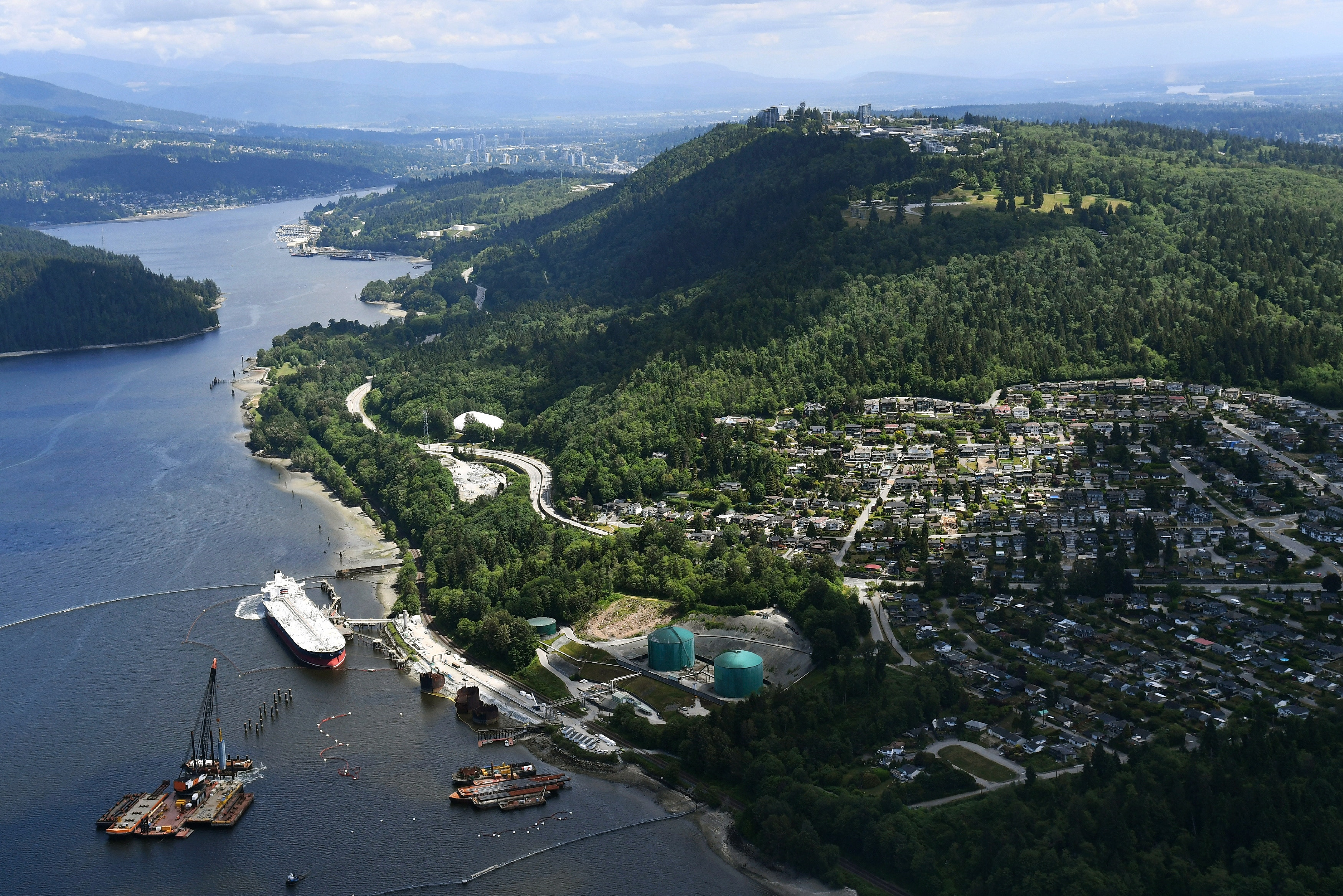 A aerial view of Kinder Morgan's Trans Mountain marine terminal, in Burnaby, British Columbia, is shown on Tuesday, May 29, 2018. The federal Liberal government is spending $ 4.5 billion to buy Trans Mountain and all of Kinder Morgan Canada's core assets, Finance Minister Bill Morneau said Tuesday as he unveiled the government's long-awaited, big-budget strategy to save the plan to expand the oil pipeline. (Jonathan Hayward/The Canadian Press via AP)