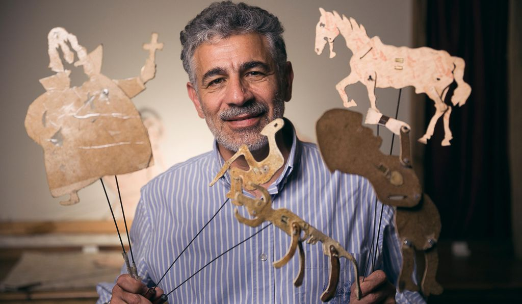 Armen Kirakosyan, director of the Ayrudzi horseback riding club and Ayrogi puppet theater, poses with shadow puppets of all shapes and sizes.