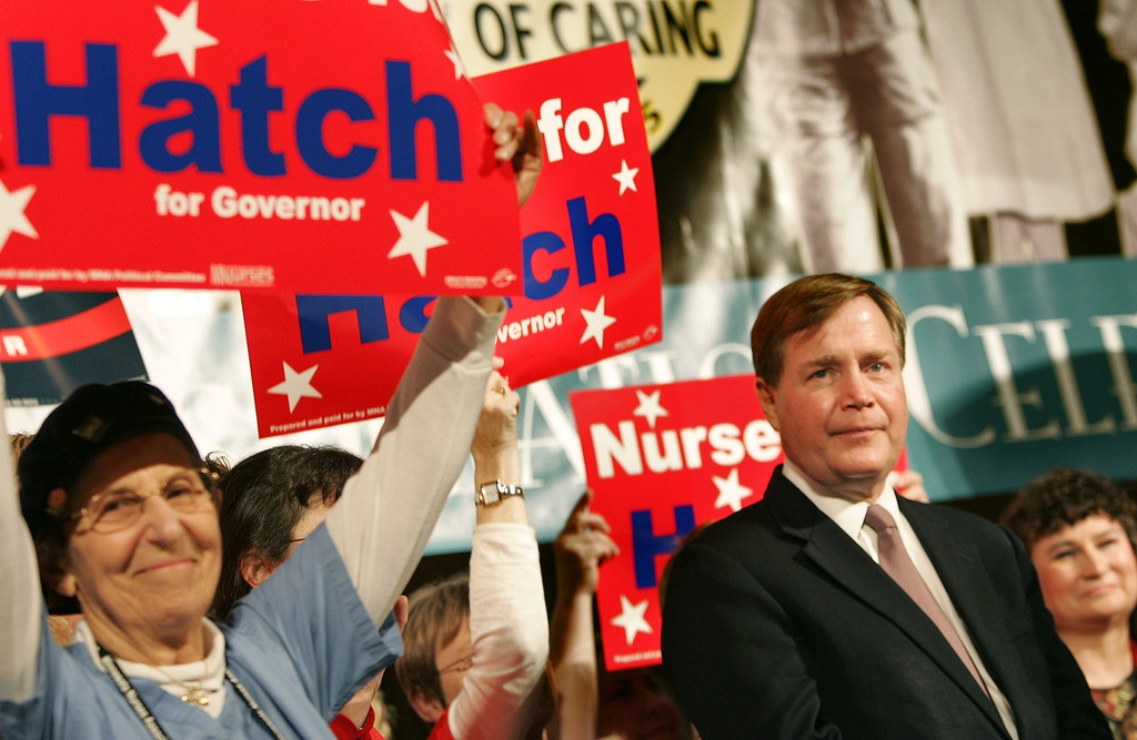 Minnesota Attorney General Mike Hatch, right, takes in the ovation as he is introduced prior to his announcement Monday, Oct. 24, 2005, in St. Paul, Minn., that he was running for governor. Hatch, a Democrat, made the announcement at a nurses convention. It will be his third shot at the governor's office. (AP Photo/Jim Mone)