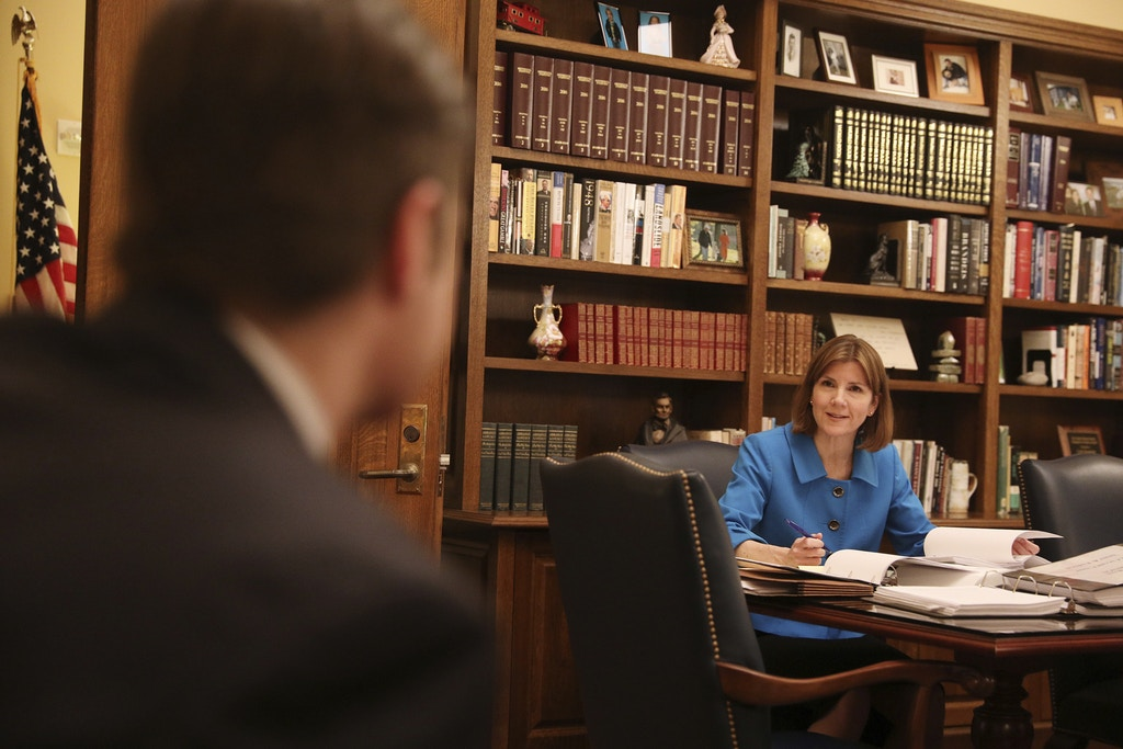 Minnesota Attorney General Lori Swanson talks with her spokesperson Ben Wogsland as she reviews evidence in the case of President Donald Trump's immigration ban targeting seven predominantly Muslim countries in her office at the State Capitol building in St. Paul, Minn., on Friday, Feb. 10, 2017. (Anthony Souffle/Star Tribune via AP)
