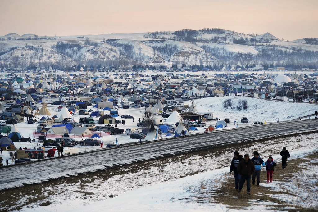 FILE - This Dec. 3, 2016, file photo shows the Oceti Sakowin camp where people have gathered to protest the Dakota Access oil pipeline near Cannon Ball, N.D. The first seasonal flood outlook from the National Weather Service indicates minor spring flooding is almost certain in the area of southern North Dakota where pipeline opponents are camping. The Friday, Jan. 27, 2017, outlook says there's little chance of major flooding but that parts of the camp area could be under water. (AP Photo/David Goldman, File)