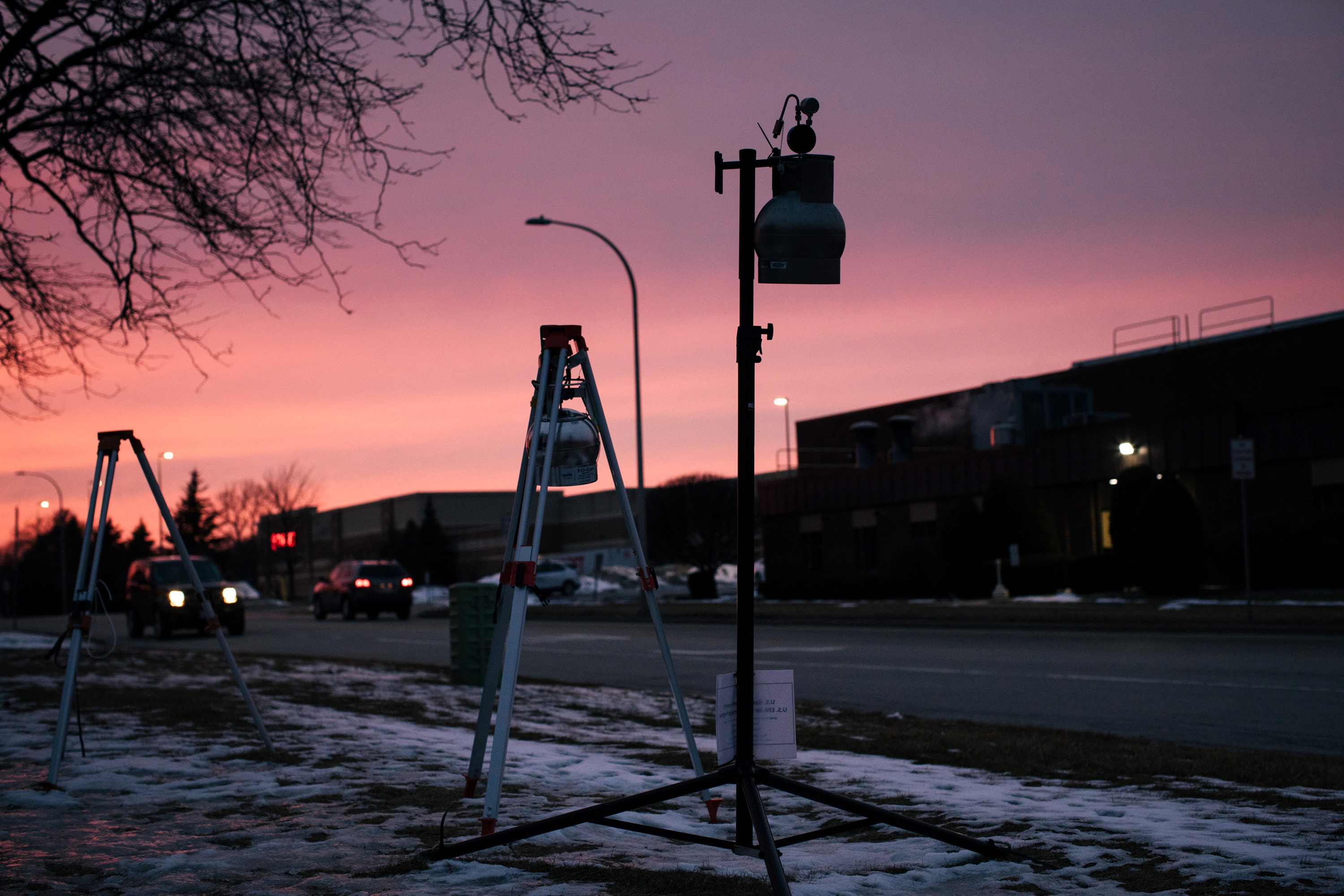 Willowbrook, Illinois -- Thursday, February 22, 2019. Air quality monitoring devices hang between the two Sterigenics buildings, one of which is seen at right, in the Willowbrook Municipal Campus. Sterigenics has been emitting a carcinogenic chemical called ethylene oxide.CREDIT: Alyssa Schukar for The Intercept
