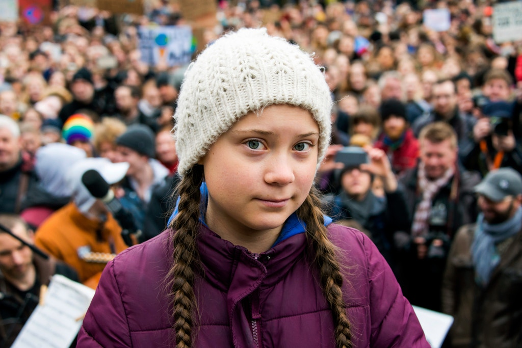 01 March 2019, Hamburg: Greta Thunberg, climate activist, stands on a stage during a rally at the town hall market. The young Swedish woman has come to Germany for the first time for a school strike for more climate protection. Photo by: Daniel Bockwoldt/picture-alliance/dpa/AP Images