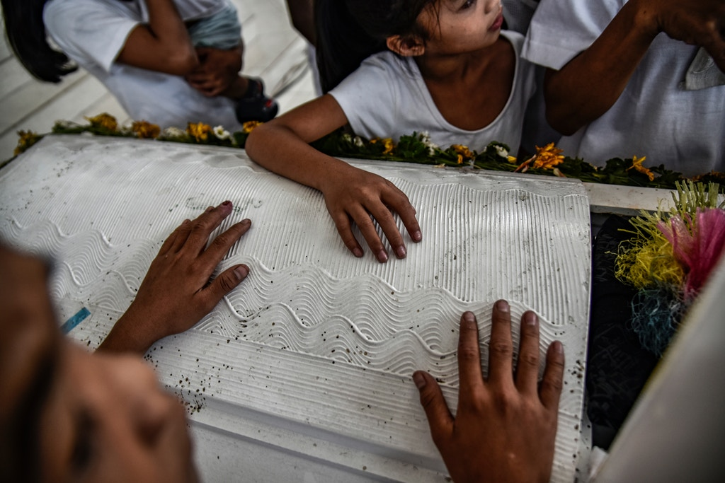 Children hold the coffin of 13-year-old Aldrin Pineda, who was shot to death by a police officer, during his funeral in Manila, Philippines, March 14, 2018. More than 27,000 have been killed as a result of a two-year war on drugs in the Philippines. In 2016, Rodrigo Duterte became president of the Southeast Asian republic. His campaign promise to fight drugs with any means won him the election: he threatened those connected to the drug trade with death, called for vigilante justice, and allowed the police to act with brutality. Human rights groups and local media have reported that dealers, users, petty criminals, and even local politicians, priests, as well as plenty of innocent people and children were murdered. The United Nations have appealed in vain to the Philippine government to investigate extrajudicial killings and to prosecute the perpetrators, while the International Criminal Court has begun preliminary inquiries into the violent acts carried out in the Philippines as well as the questionable methods of Duterte and the police.Photo: Ezra Acayan/NurPhoto (Photo by Ezra Acayan/NurPhoto via Getty Images)