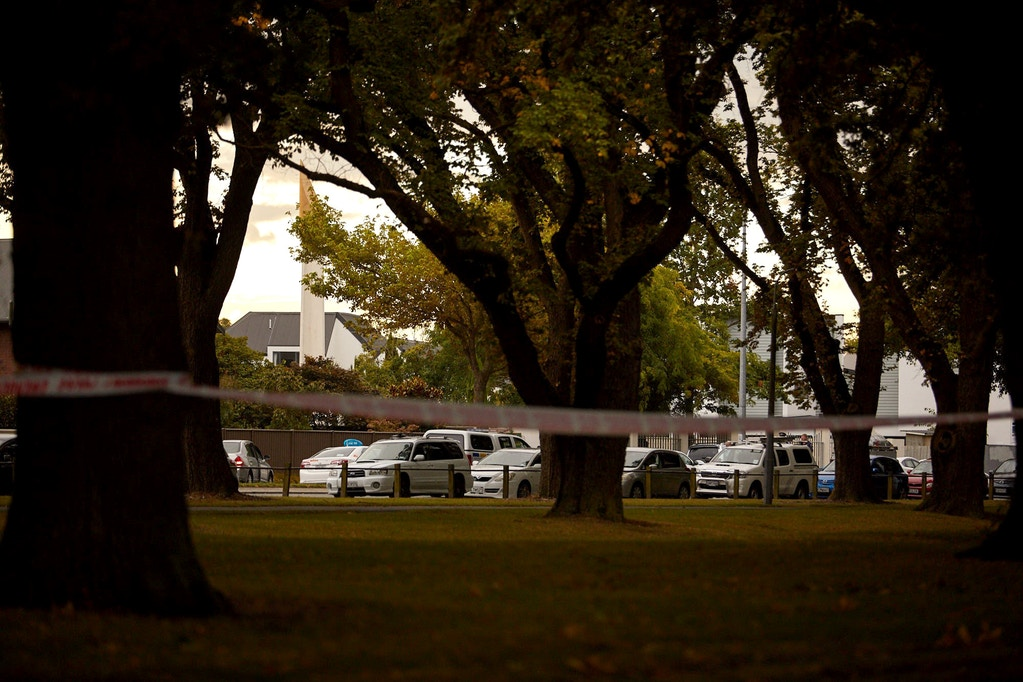 CHRISTCHURCH, NEW ZEALAND - MARCH 15: Police officers cordon off the area as they inspect the Al Noor Mosque, the shooting site, after gunmen attacked the two mosques and fired multiple times during Friday prayers in Christchurch, New Zealand on March 15, 2019. At least 40 people were reportedly killed in twin terror attacks targeting mosques in Christchurch, New Zealand, an official said on Friday. Witnesses claim the Al Noor Mosque was targeted by armed assailants and there were up to 200 people inside for Friday Prayers. (Photo by Diederik van Heyningen/Anadolu Agency/Getty Images)