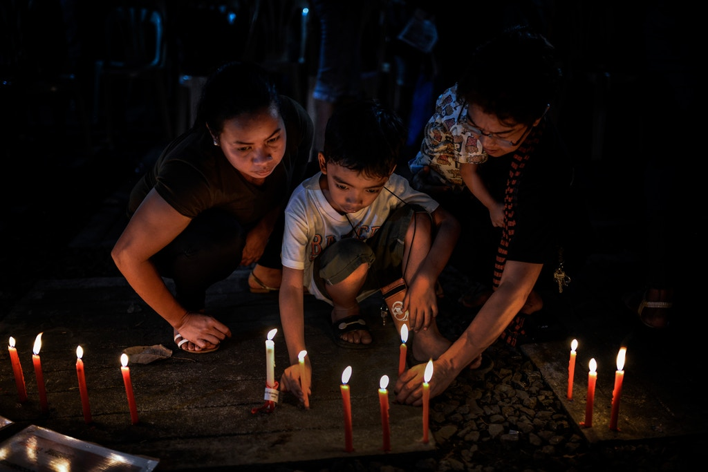 Relatives of victims of extrajudicial killings light candles next to pictures of their loved ones during a vigil in Quezon city, Metro Manila, Philippines, December 1, 2017. On International Human Rights Day, thousands of Philippine President Rodrigo Duterte's critics marched the streets to condemn what they say are the many human rights violations under his watch. The protests come in light of the recent killings of activist leaders and indigenous peoples, the alleged human rights abuses by the military during the siege of Islamic State militants in Marawi, the thousands killed in the government's deadly campaign against illegal drugs, and Duterte's proclamation labeling communist rebels and left-wing groups as terrorists. Photo: Ezra Acayan/NurPhoto (Photo by Ezra Acayan/NurPhoto via Getty Images)