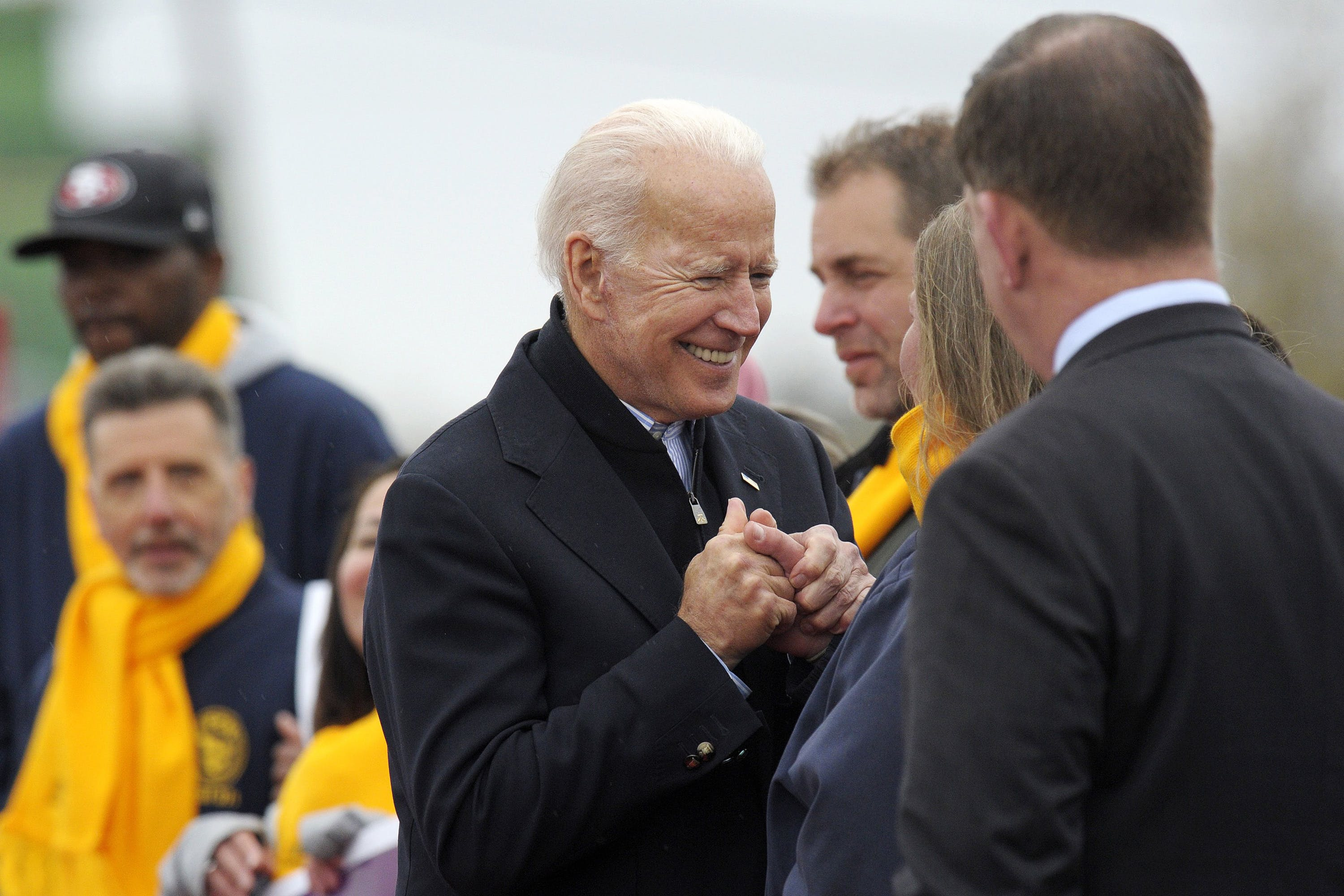 Former US vice president Joe Biden greets people as he prepares to leave a rally organized by UFCW Union members to support Stop and Shop employees on strike throughout the region at the Stop and Shop in Dorchester, Massachusetts, April 18, 2019. - The 76-year-old Biden has not yet officially thrown his hat in the ring for the 2020 presidential election. (Photo by JOSEPH PREZIOSO / AFP)