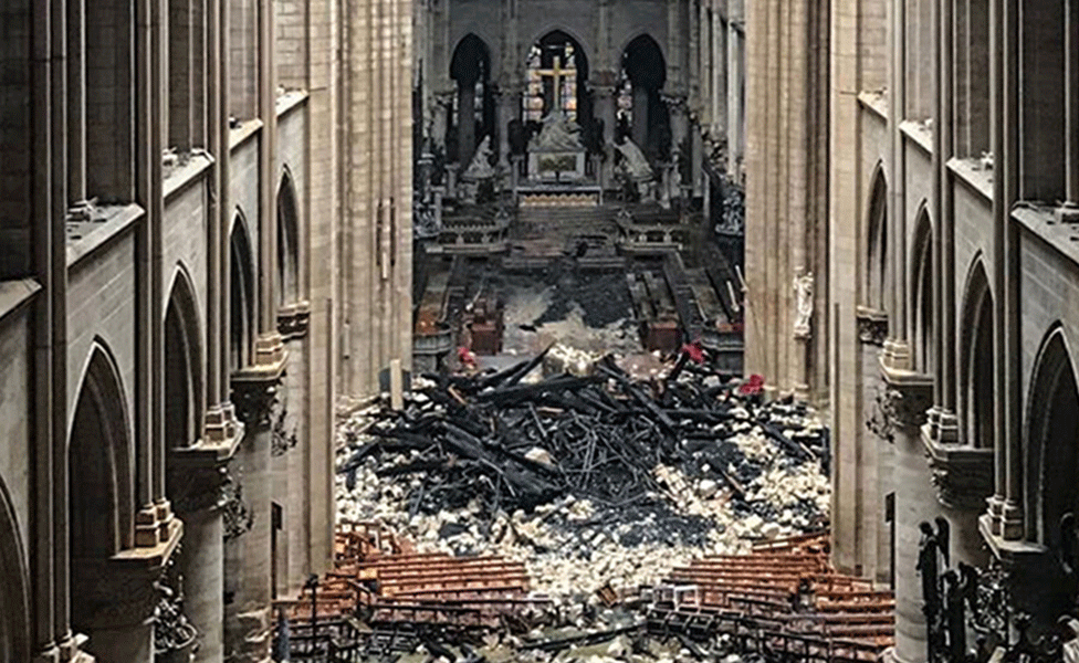 Debris of the fallen spire inside Notre Dame