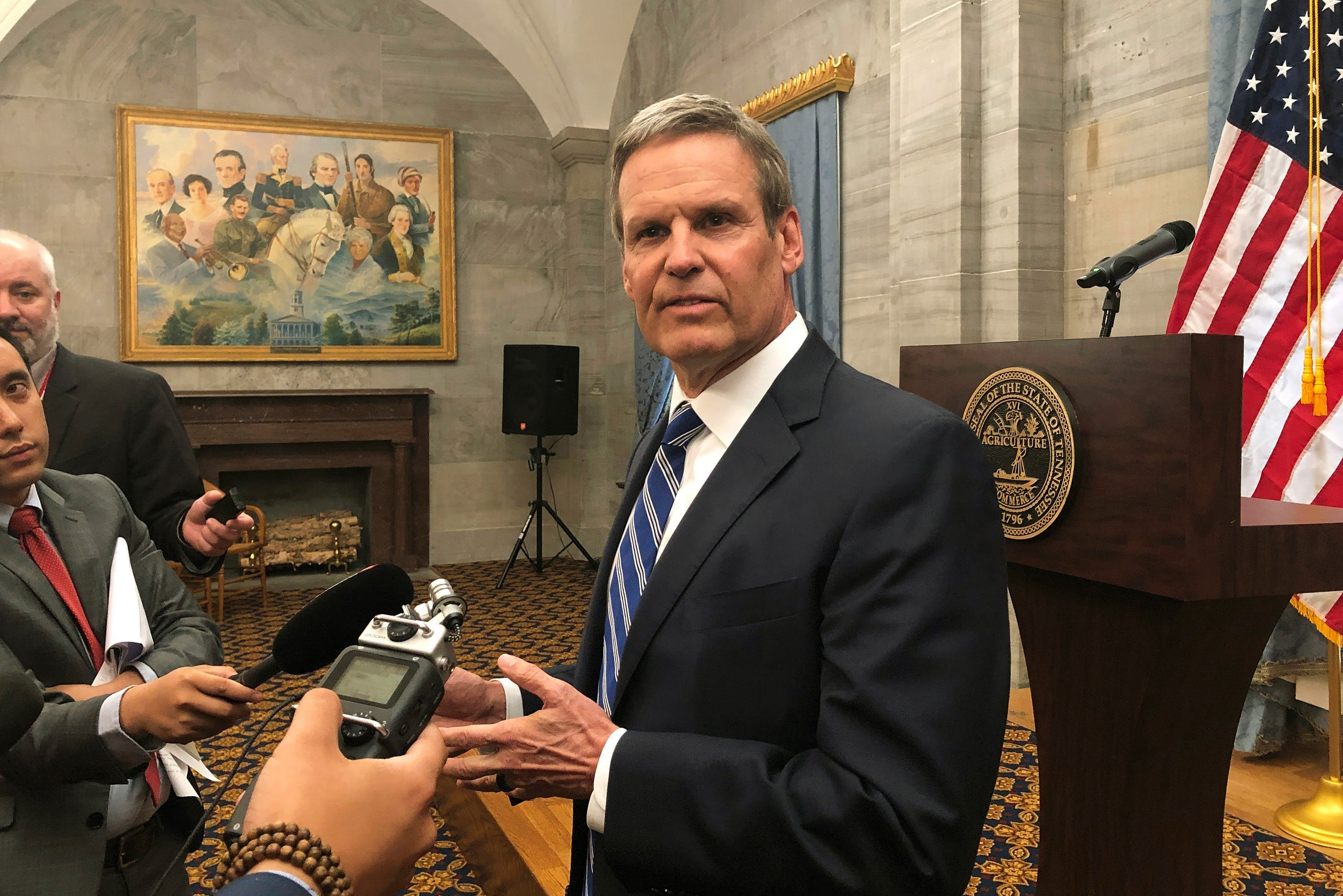 FILE - In this April 25, 2019 file photo, Republican Tennessee Gov. Bill Lee talks to reporters at the Capitol in Nashville, Tenn. More than half of Lee's newly appointed cabinet members, including his education czar and Tennessee's Medicaid chief, didn't submit applications or provide any documents outlining why they deserved the jobs he gave them. The Associated Press reviewed all applications submitted to Lee's office during his transition into the top statewide position.  This included submissions for both cabinet spots and lower level jobs inside the executive branch. (AP Photo/Kimberlee Kruesi, File)