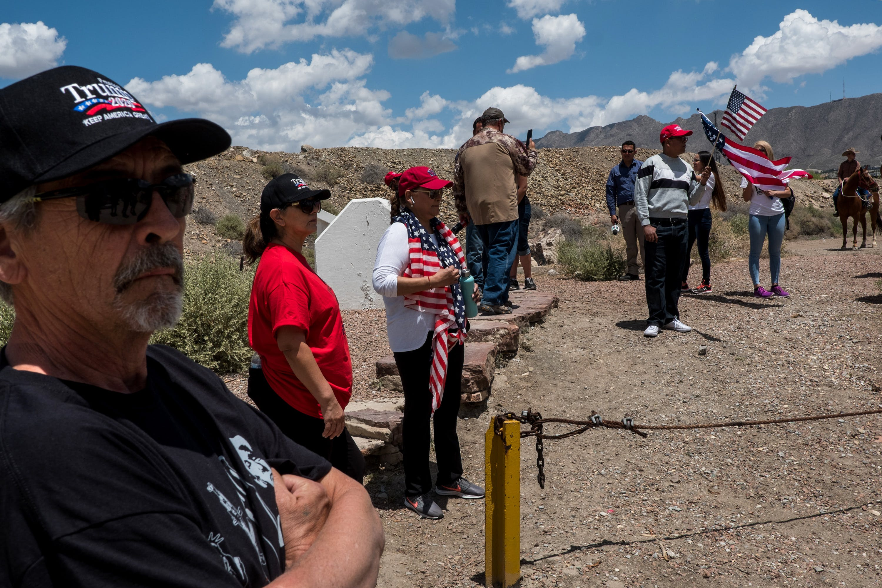Sam Esquivel, left, Nancy Esquivel and Jacqueline Torres gather near Monument One at the U.S.-México border on the outskirts of Sunland Park, New Mexico, Saturday, May 11, 2019. (Joel Angel Juárez for The Intercept)