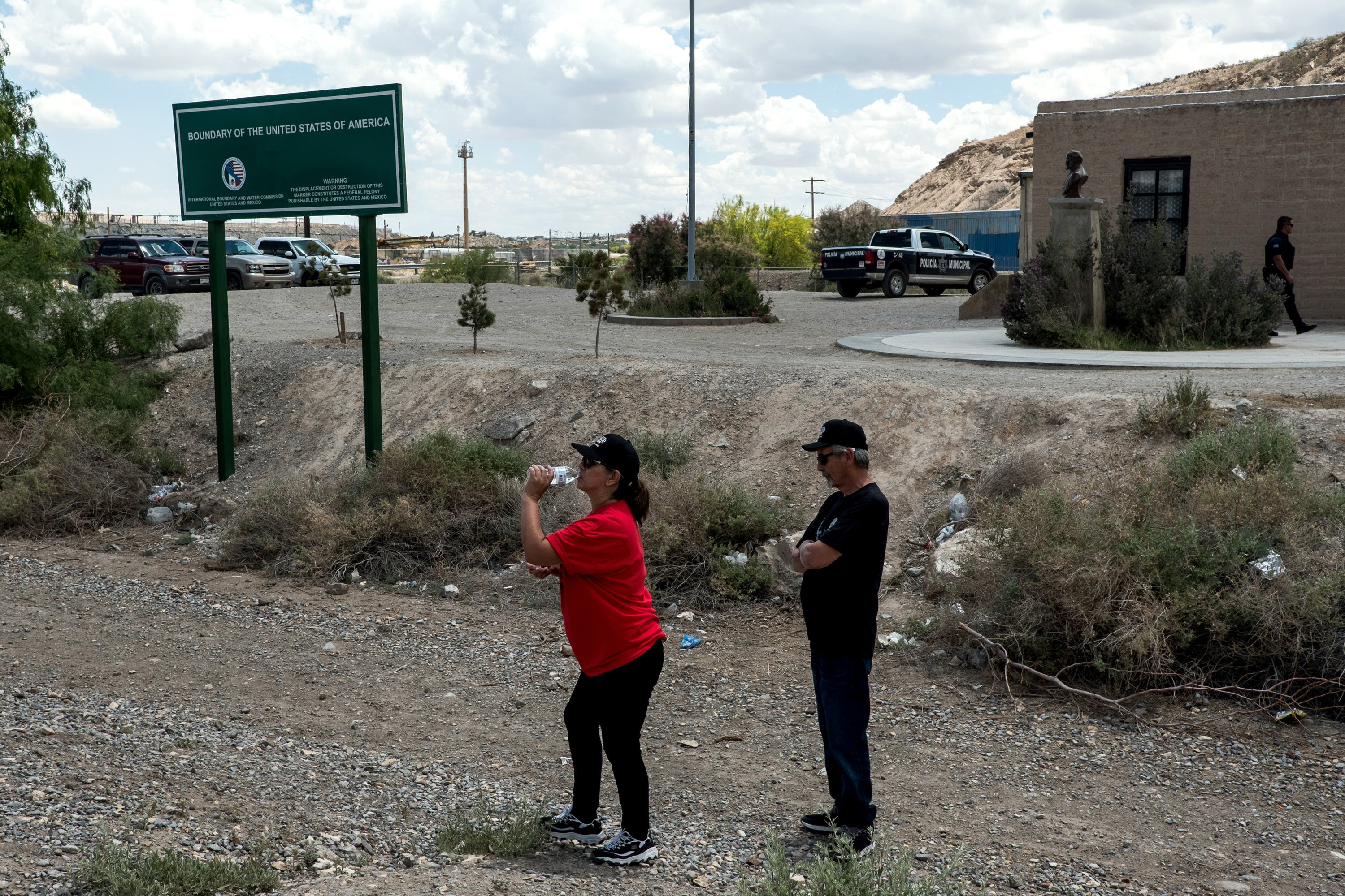Nancy Esquivel and her husband Sam, both of El Paso, walk nearby the U.S.-México border on the outskirts of Sunland Park, New Mexico, Saturday, May 11, 2019. Both had crossed into México and back without being apprehended by officials on either side. (Joel Angel Juárez for The Intercept)