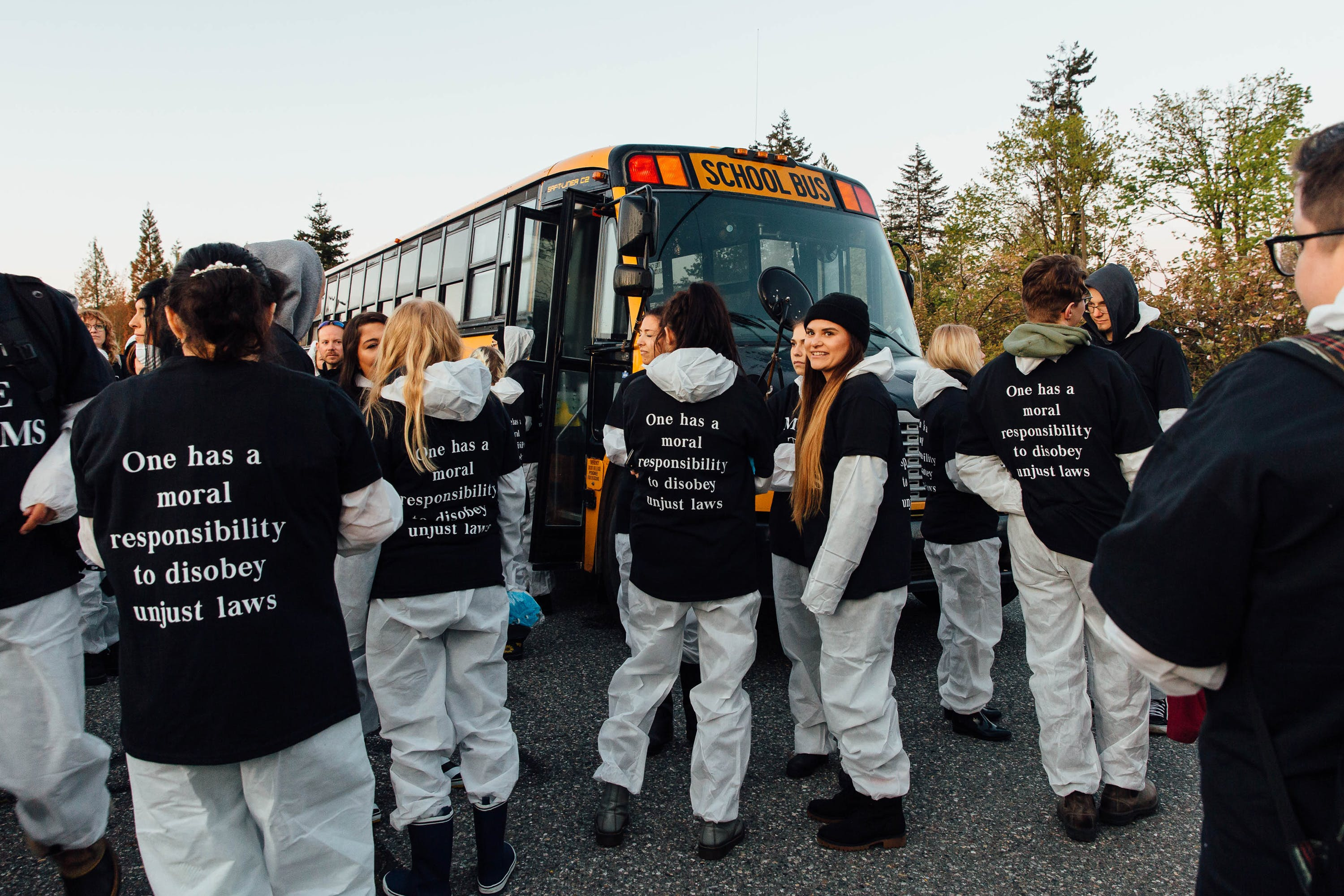 Animal rights activists prepare to board a bus going to the Excelsior Hog Farm in Abbotsford, B.C. on April 28, 2019.
