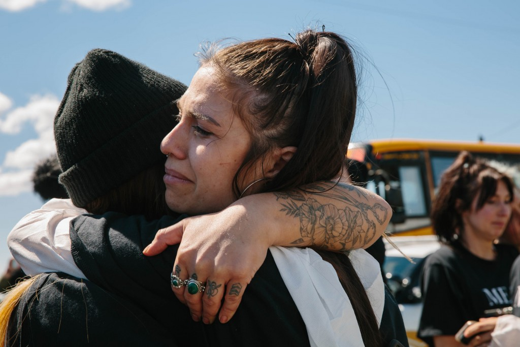 After exiting the Excelsior Hog Farm in Abbotsford, B.C. animal rights activists cry and embrace each other. April 28, 2019