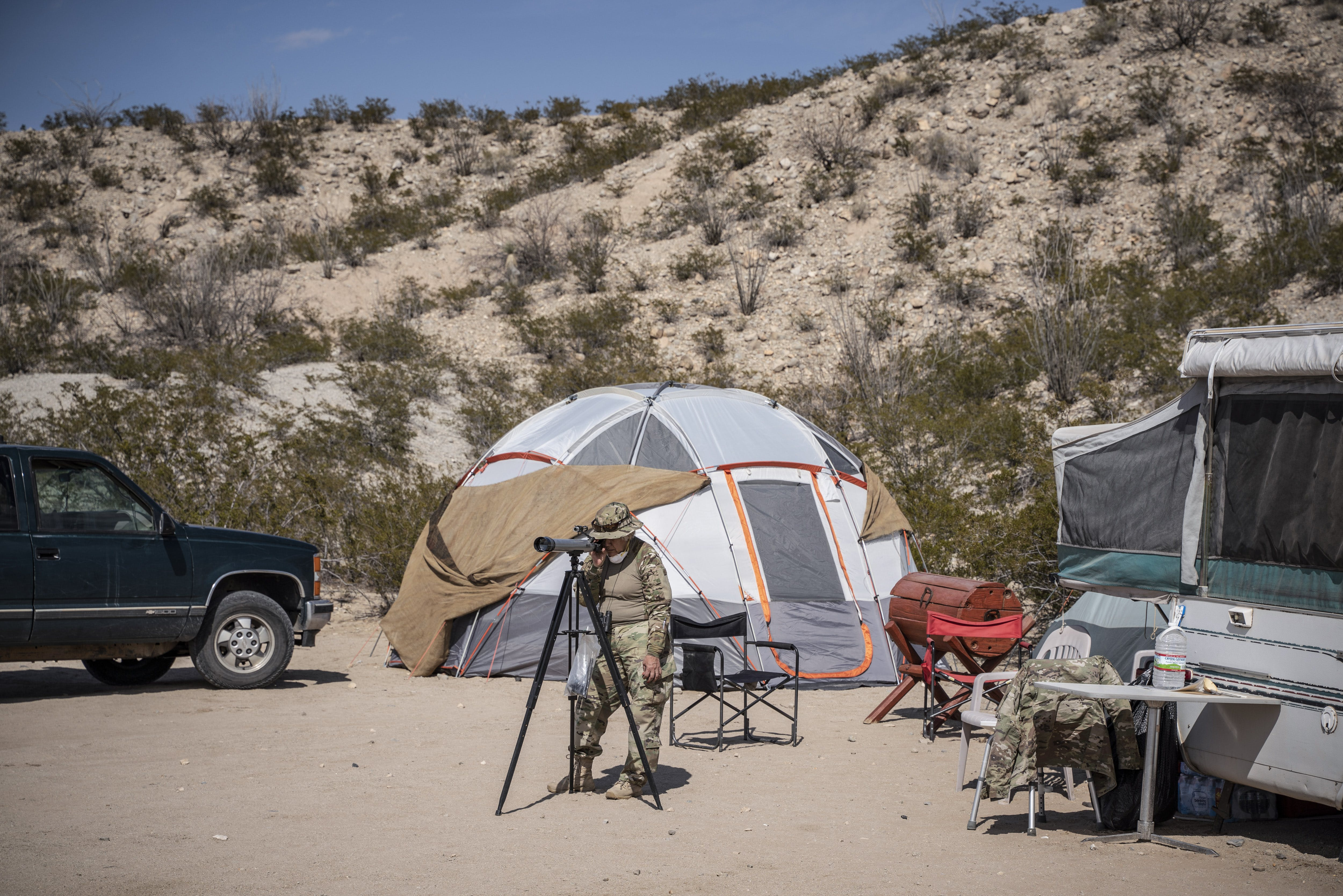"A member of United Constitutional Patriots New Mexico Border Ops militia team monitors the US-Mexico border in Anapra, New Mexico on March 20, 2019. - The militia members say they will patrol the US-Mexico border near Mt. Christo Rey, ""Until the wall is built."" In recent months, thousands of Central Americans have arrived in Mexico in several caravans in the hope of finding a better life in the United States. US President Donald Trump has branded such migrants a threat to national security, demanding billions of dollars from Congress to build a wall on the southern US border."