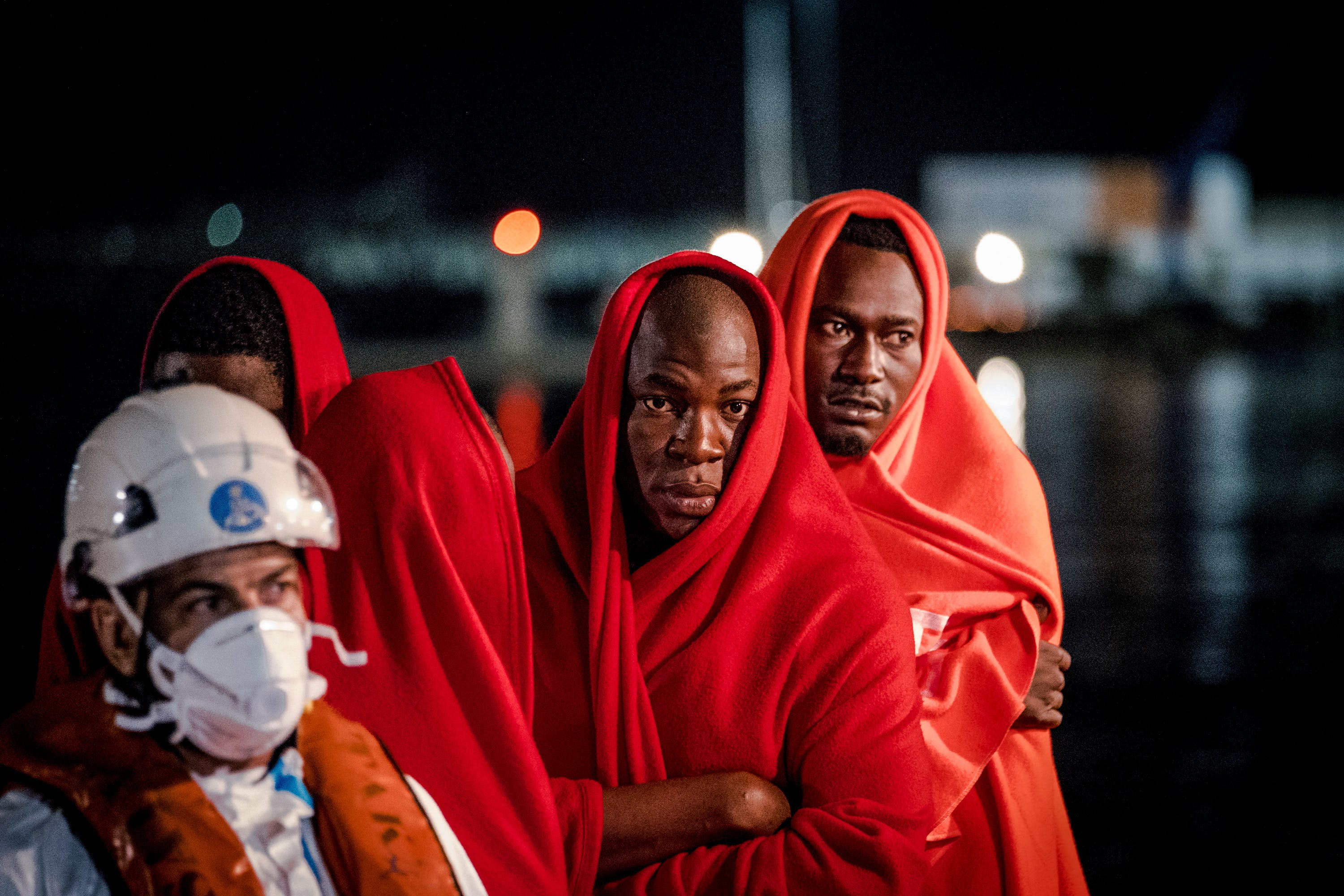 A group of men waits onboard the vessel to disembark at Malaga's port. Even though the number of migrants reaching Europe by sea has considerably decreased, crossing the Mediterranean is still extremely risky. During the five first months of the year 2019, more than 500 persons died.