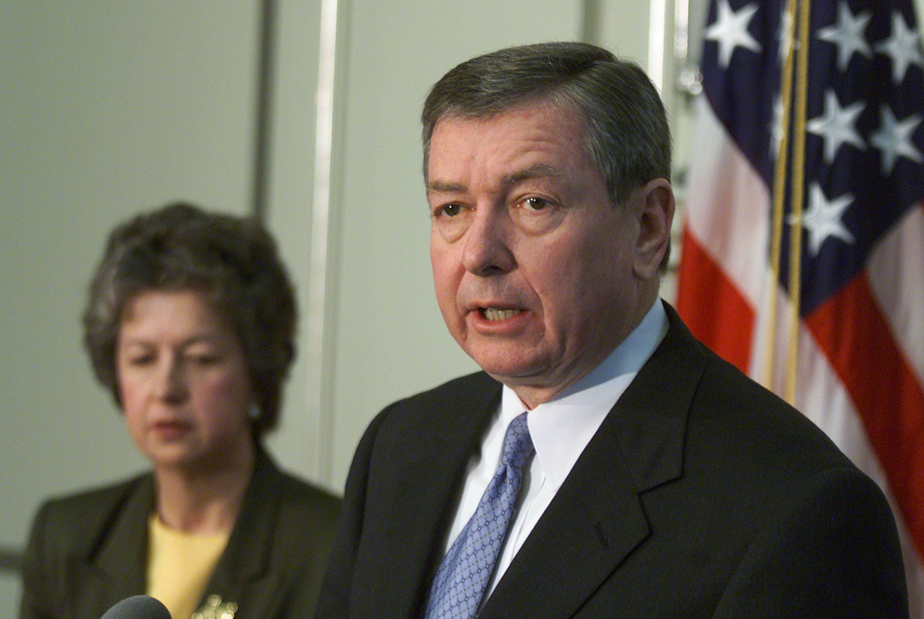 387784 01: Attorney General John Ashcroft, right, speaks about the execution of Timothy McVeigh, as the Federal Bureau of Prisons Director Kathleen Hawk Sawyer looks on, April 12, 2001 at the Justice Department in Washington, DC. Ashcroft announced that the execution will be made available to view on a closed circuit television for victims and relatives of the Oklahoma City bombing. (Photo by Mark Wilson/Newsmakers)