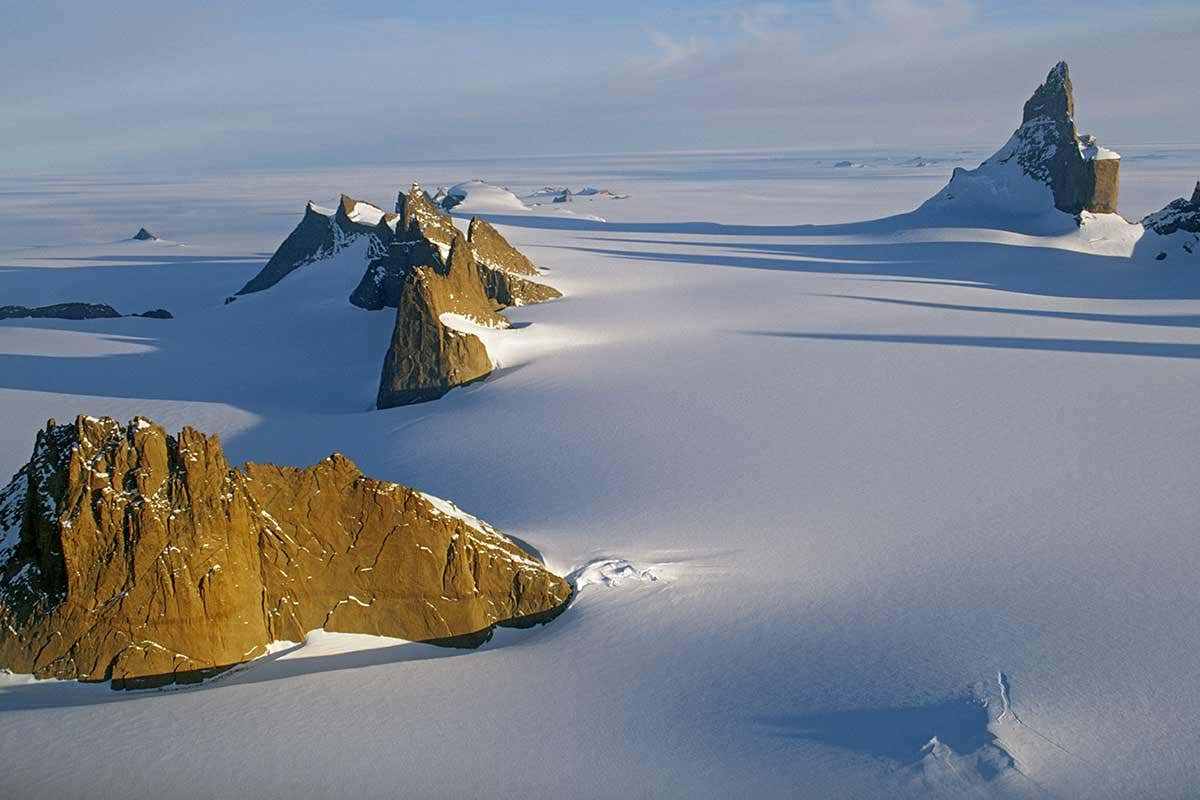 Antarctic snow amid mountains