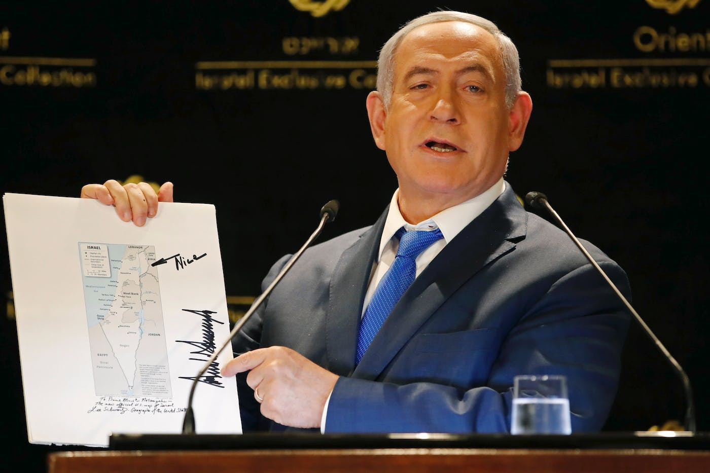 Israeli Prime Minister Benjamin Netanyahu displays a map of Israel indicating the Golan Heights are inside the state's borders, signed by US president Donald Trump and handed over to him by the president's son-in-law and adviser Jared Kushner during the same day, as he speaks in a hotel of Jerusalem on May 30, 2019. - Israeli Prime Minister Benjamin Netanyahu was confronted with one of the biggest defeats of his political career on May 30 after failing to form a coalition and opting instead to hold an unprecedented second election. (Photo by Thomas COEX / AFP)        (Photo credit should read THOMAS COEX/AFP/Getty Images)
