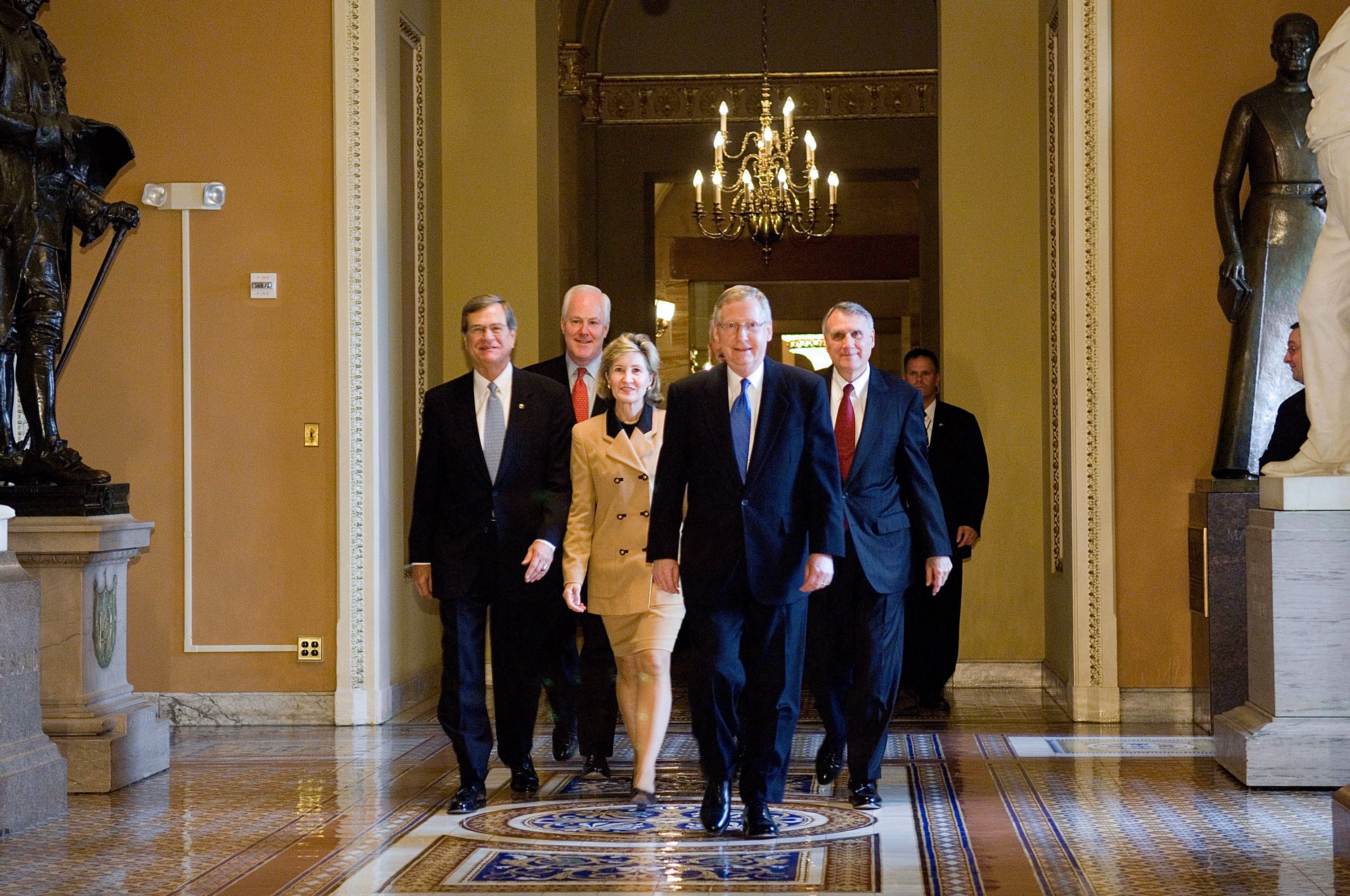 """UNITED STATES - NOVEMBER 15:  Senators elected by colleagues to serve as leadership for Republicans in the 110th Congress, which commences in January 2007, emerge from their caucus meeting at the U.S. Capitol. Left to right: Senate Minority Whip Sen. Trent Lott, R-Miss., the No. 2 minority leadership post; Vice Chairman of the Republican Conference John Cornyn, R-Texas; Republican Policy Committee Chair Kay Bailey Hutchison, R-Texas; Senate Minority Leader Mitch McConnell, R-Ky., and Republican Conference Chairman Jon Kyl, R-Ariz; and (not pictured) National Republican Senatorial Committee Chairman John Ensign, R-Nev. Senate Republicans proved on Wednesday that there can indeed be second acts in politics, electing their former leader Trent Lott of Mississippi to the No. 2 minority leadership post for the 110th Congress. Lott prevailed over Lamar Alexander, R-Tenn., by a single vote in a race he jumped into only this week, after the Nov. 7 elections gave Democrats control of the Senate by a 51-49 margin. Alexander began lining up support nearly a year ago. Lott, 65, will serve as GOP whip under newly anointed Minority Leader Mitch McConnell, R-Ky., who was unopposed in his bid to succeed retiring Majority Leader Bill Frist, R-Tenn. McConnell has served as whip for the past four years. """"It was just a choice of two styles and two sets of experience,"""" Alexander said. """"Senators, like most Americans, like a comeback.""""  (Photo by Scott J. Ferrell/Congressional Quarterly/Getty Images)"""