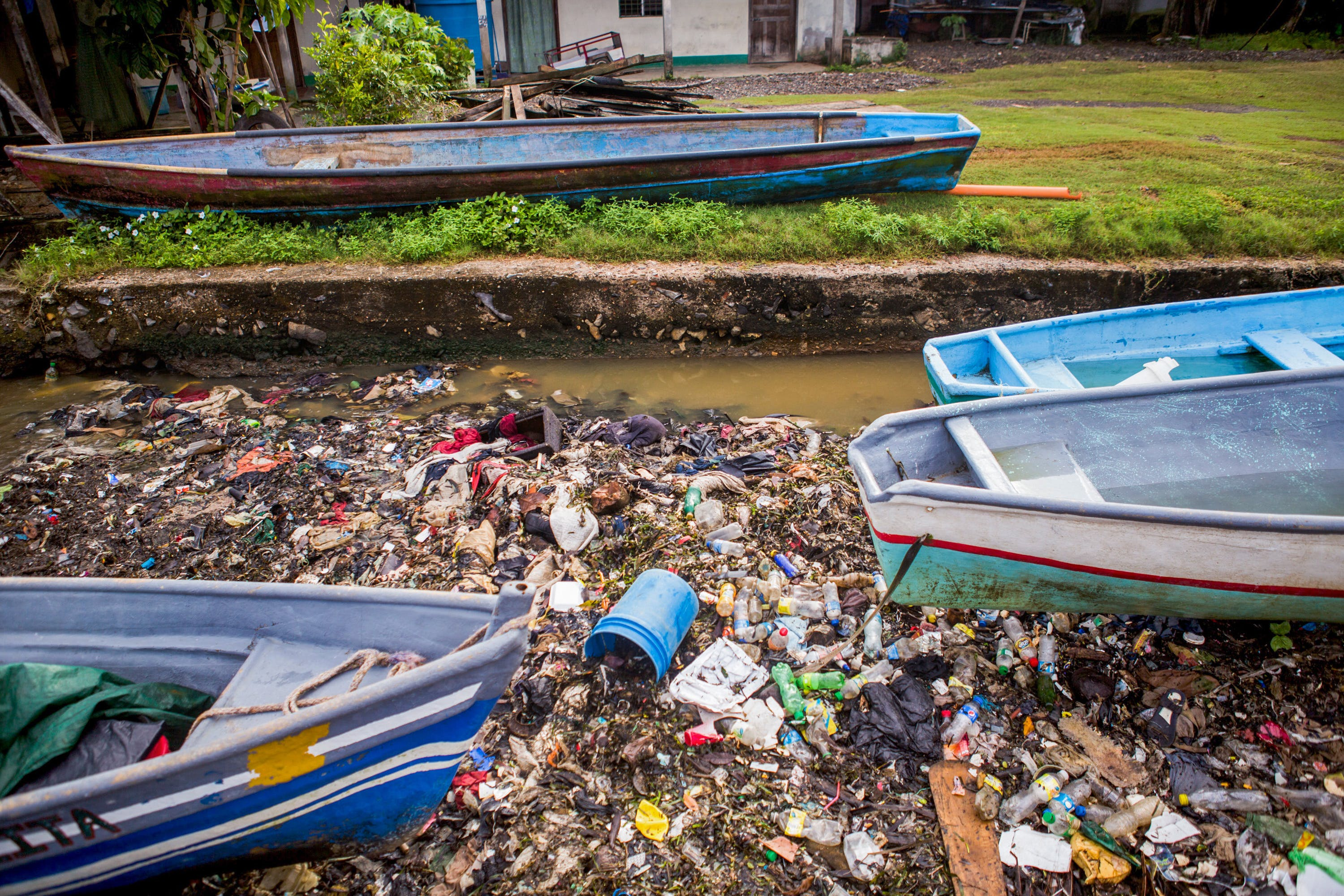 Trash collects in an inlet in the neighboring bay of Puerto Barrios, Izabal, Guatemala, where  fishing makes up a critical  part of the economy on Saturday, September 29th, 2018.