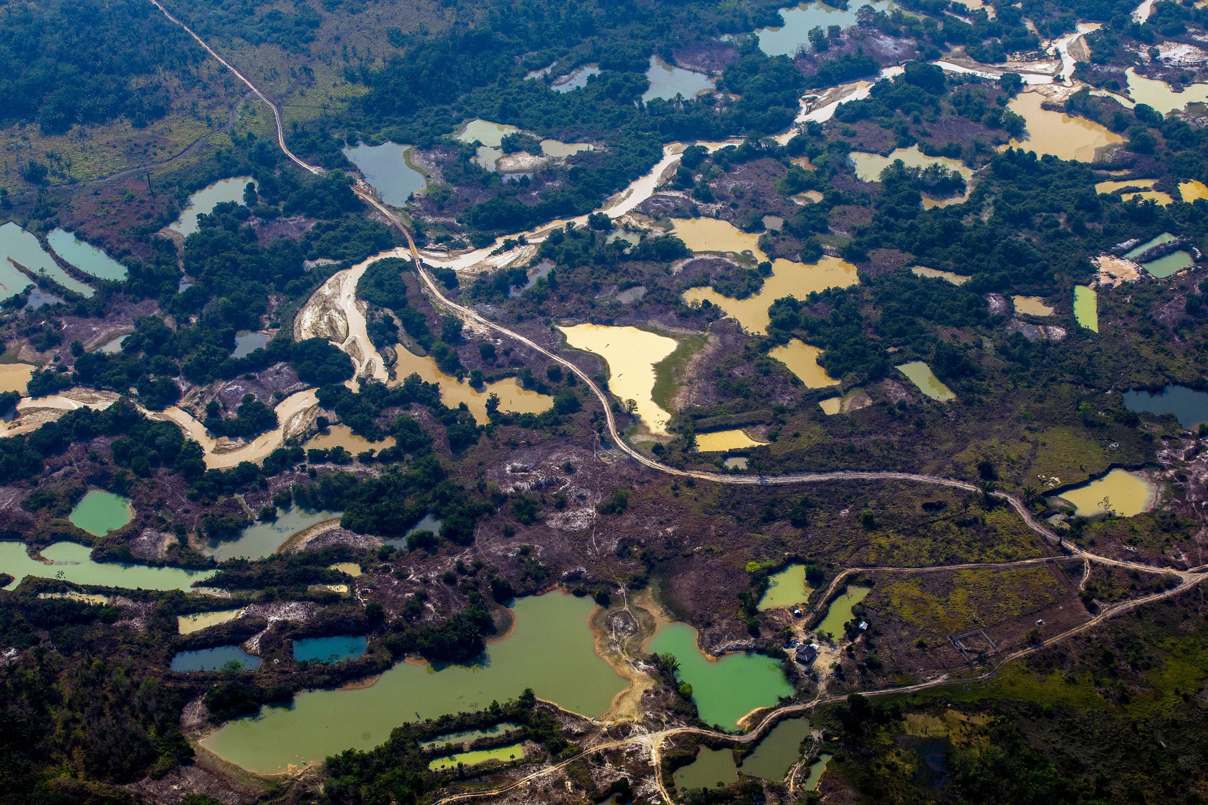 Aerial view the Esperanca IV informal gold mining camp, near the Menkragnoti indigenous territory, in Altamira, Para state, Brazil, in the Amazon basin, on August 28, 2019. (Photo by Joao LAET / AFP)        (Photo credit should read JOAO LAET/AFP via Getty Images)