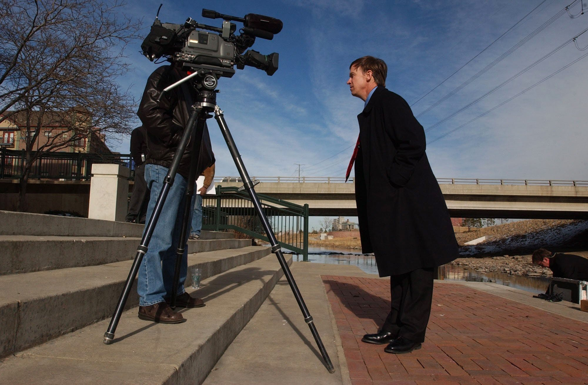 Denver, Colo., Feb , 2002 -- Denver businessman John Hickenlooper campaigns for mayor of Denver - talking to the television camera - after rolling out his water policy in Confluence Park. Photo by Brian Brainerd  (Photo By Brian Brainerd/The Denver Post via Getty Images)