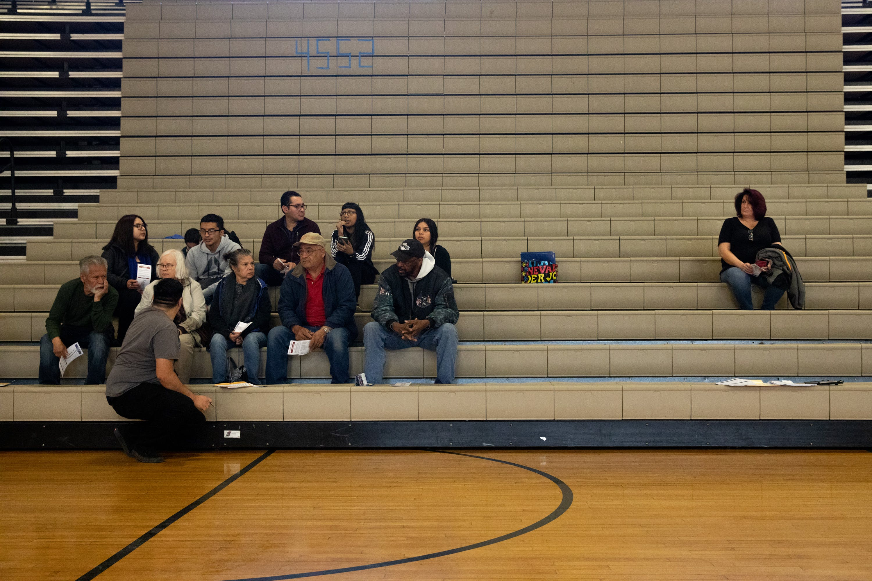 Voters wait for the tally at the Nevada Caucuses at Desert Pines Highschool in Las Vegas, Nevada on February 22nd, 2020. On the left Bernie Sanders supporters, on the right one Tulsi Gabbard voter. Krystal Ramirez for The Intercept