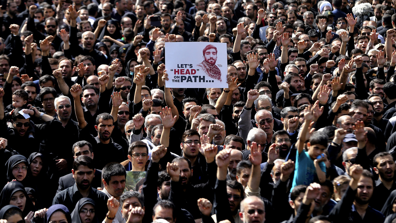 Thousands of Iranians attend the funeral of Mohsen Hojaji, an Iranian soldier beheaded by ISIS in Syria, in Tehran, Iran, Sept. 27, 2017.(AP/Ebrahim Noroozi)