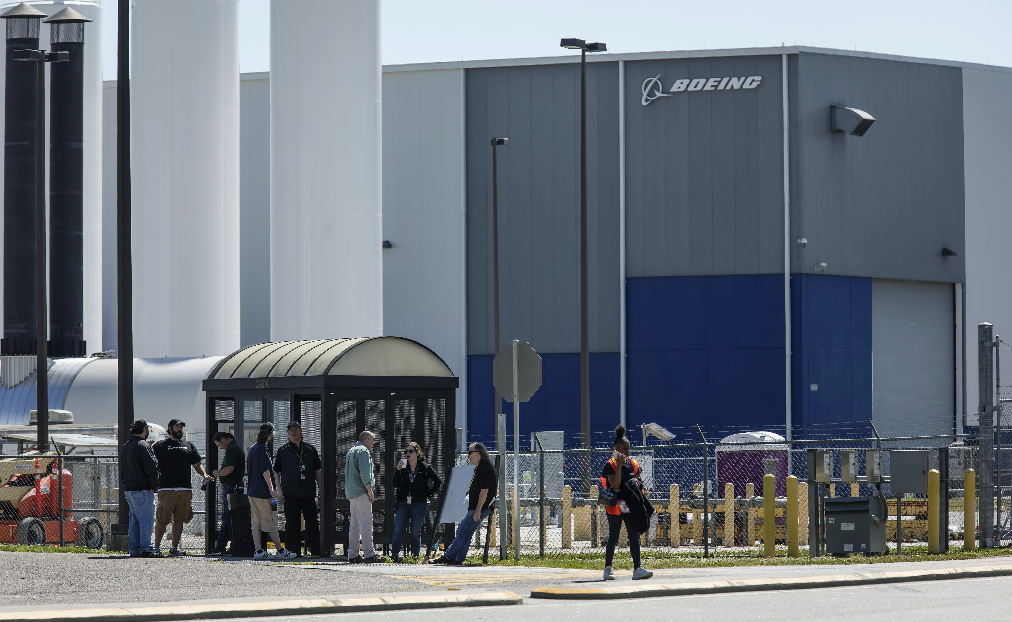 Workers stand outside the Boeing Co. manufacturing facility in North Charleston, South Carolina, U.S., on Monday, May 4, 2020. Boeing is restarting its 787 operations at the plant for the first time since April 8, including all operations that were suspended because of the Covid-19 pandemic, ABC News reported. Photographer: Sam Wolfe/Bloomberg via Getty Images
