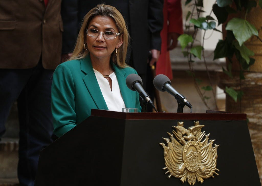 """Bolivia's interim President Jeanine Anez addresses the nation at the presidential palace in La Paz, Bolivia, Wednesday, Jan. 22, 2020. The message marked the anniversary of the naming of Bolivia as the """"Plurinational State of Bolivia,"""" by former President Evo Morales. (AP Photo/Juan Karita)"""