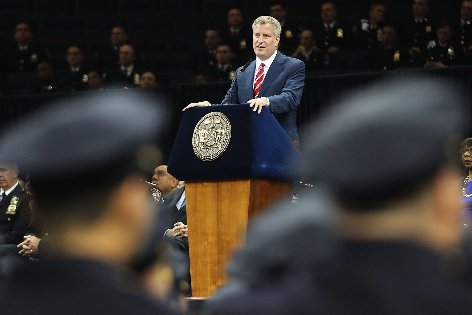NEW YORK, NY - JULY 01:  New York City Mayor Bill de Blasio speaks to new members of New York City's police department's graduating class during a swearing in ceremony at Madison Square Garden on July 1, 2016 in New York City. The New York City Police Department's (NYPD) current uniformed strength is approximately 34,500.  (Photo by Spencer Platt/Getty Images)