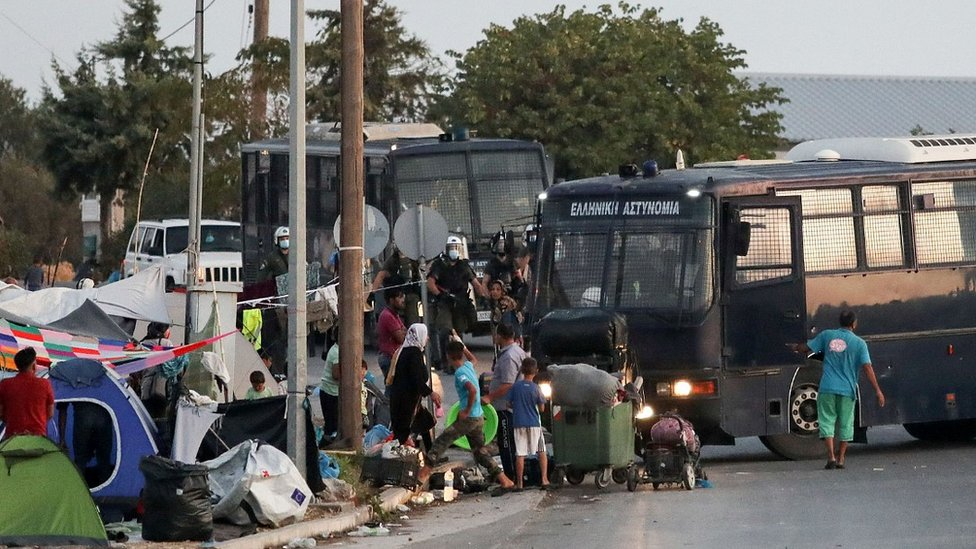 Police bus and migrants on Lesbos, 17 Sep 20