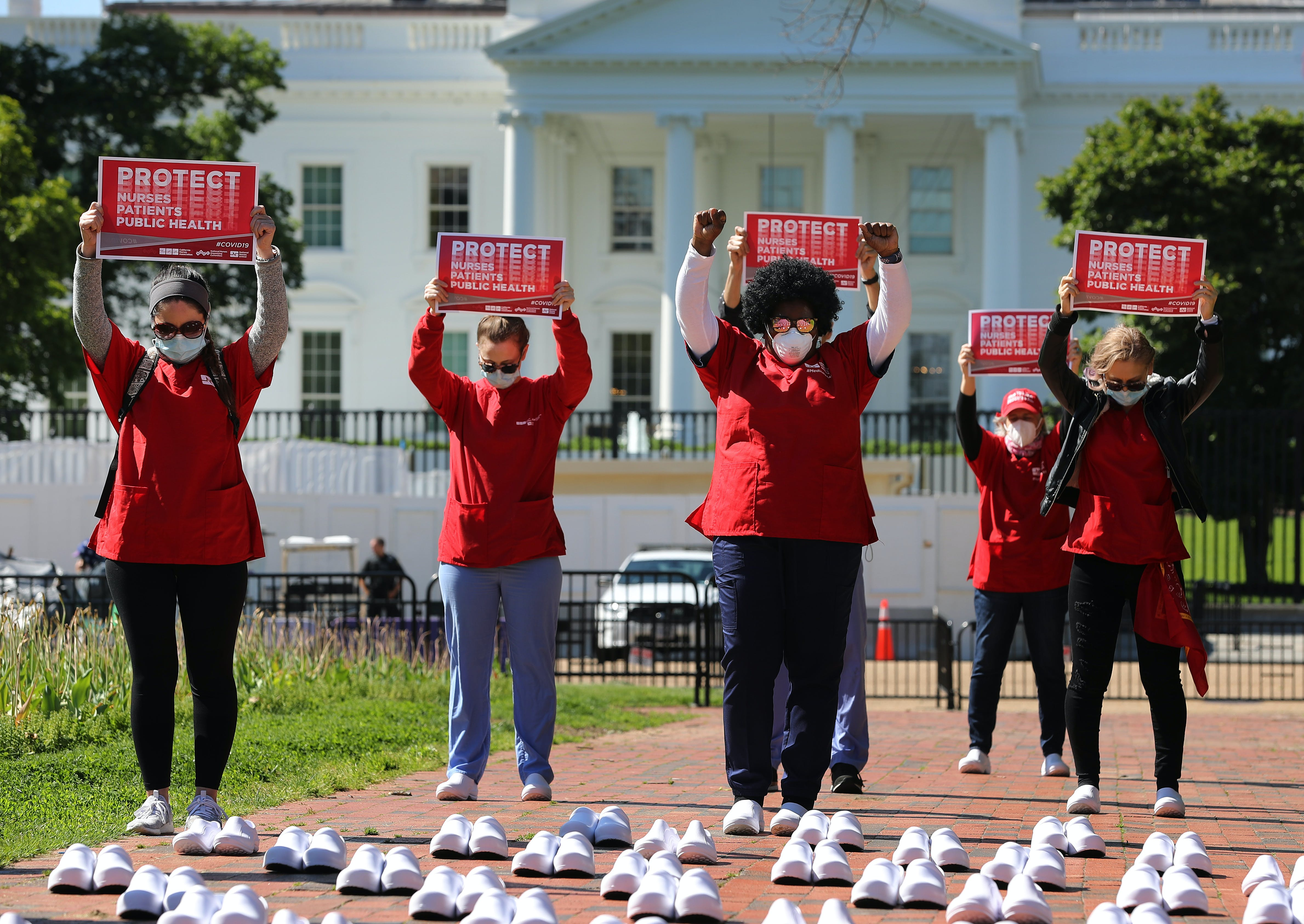 Members of the National Nurses United observe a moment of silence for the 88 nurses they say have died from COVID-19 while demonstrating in Lafayette Park across from the White House May 07, 2020 in Washington, DC.