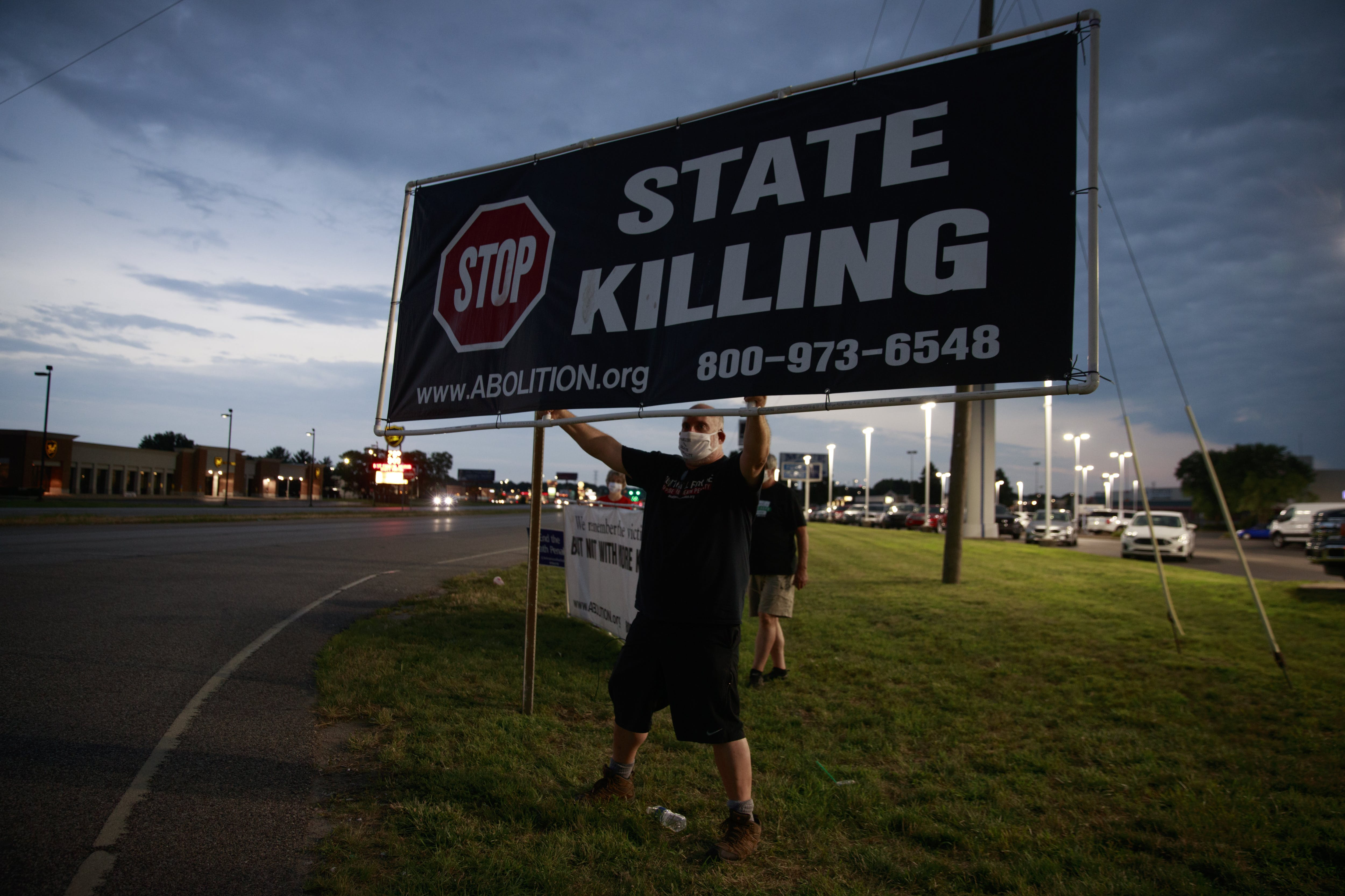 TERRE HAUTE, INDIANA, UNITED STATES - 2020/07/15: Abe Bonowitz of Death Penalty Action, an execution abolitionist group, protests near the Terre Haute Federal Correctional Complex where death row inmate Wesley Ira Purkey was scheduled to be executed by lethal injection.Purkey's execution scheduled for 7 p.m., was delayed by a judge. Purkey suffers from Dementia, and Alzheimer's disease. Wesley Ira Purkey was convicted of a gruesome 1998 kidnapping and killing. (Photo by Jeremy Hogan/SOPA Images/LightRocket via Getty Images)