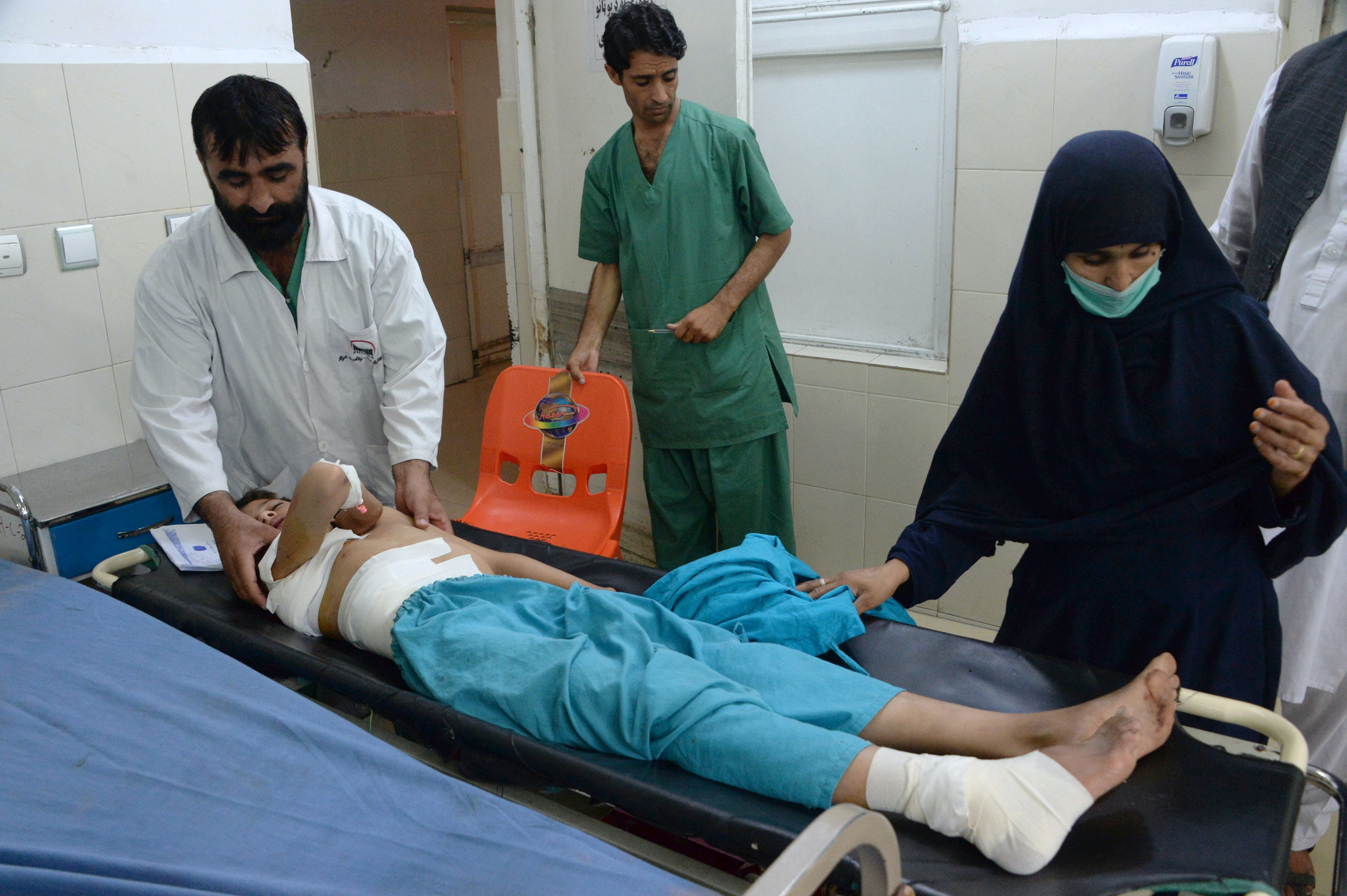 An injured Afghan youth receives treatment at a hospital following a suspected US drone airstrike in the Achin district of Nangarhar province on September 28,2016.