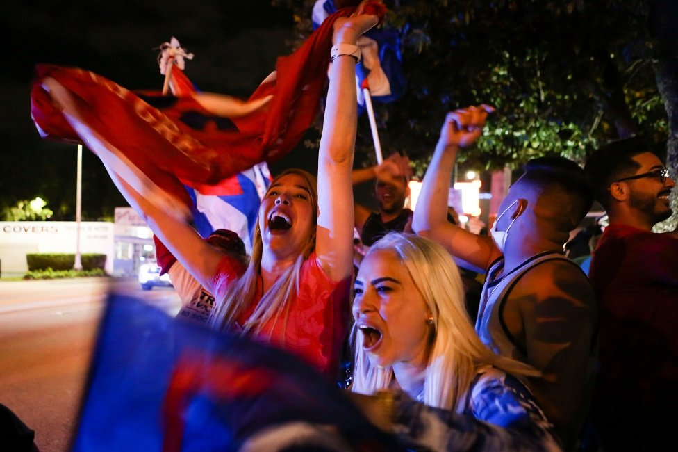 Supporters of US President Donald Trump rally in front of Cuban restaurant Versailles in Miami, Florida on 3 November