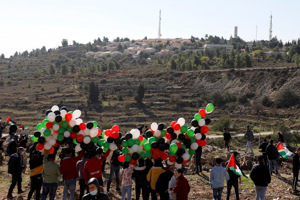 Palestinians protest near the settlement of Psagot in the occupied West Bank on 18 November 2020
