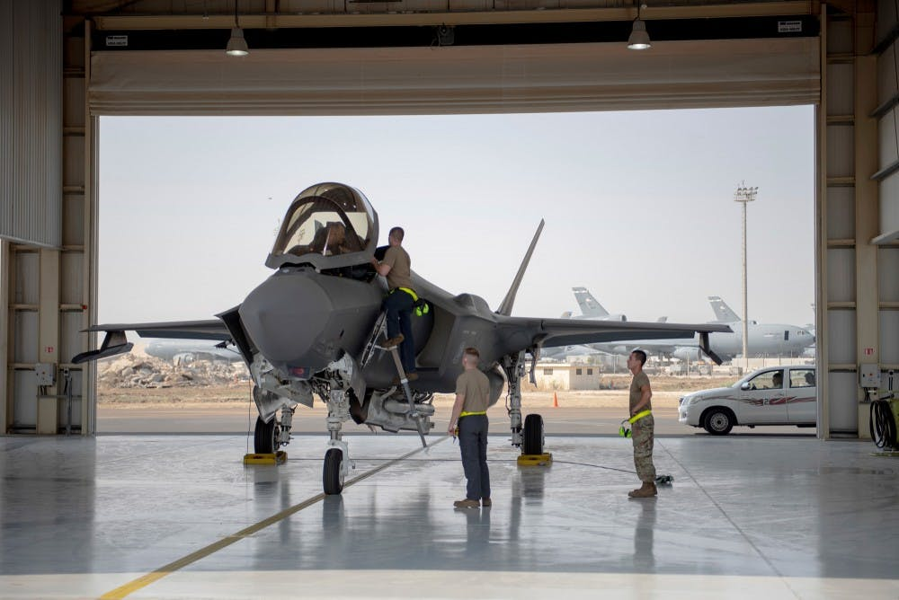 In this Aug. 5, 2019, photo released by the U.S. Air Force, an F-35 fighter jet pilot and crew prepare for a mission at Al-Dhafra Air Base in the United Arab Emirates. The Trump administration has formally notified Congress that it plans to sell 50 advanced F-35 fighter jets to the United Arab Emirates as part of a broader arms deal worth more than $ 23 billion. (Staff Sgt. Chris Thornbury/U.S. Air Force via AP)