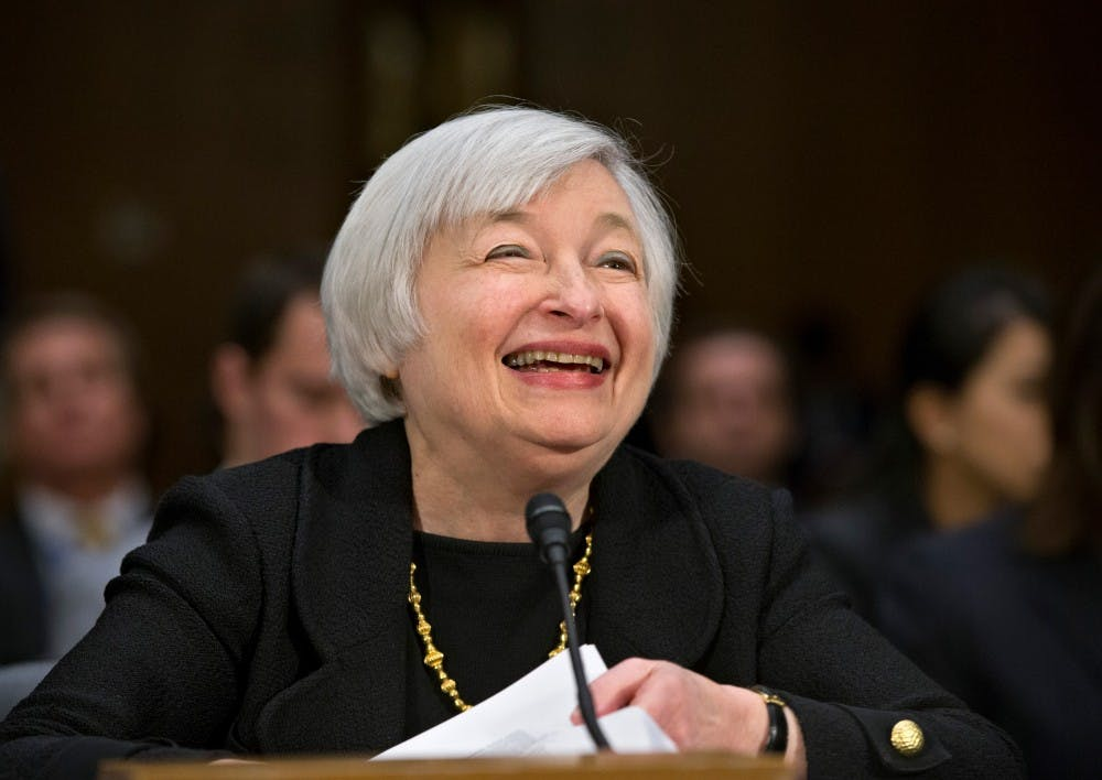 Janet Yellen, President Obama's nominee to succeed Ben Bernanke as Federal Reserve chairman, smiles as she finishes testifying at her confirmation hearing before the Senate Banking Committee on Capitol Hill in Washington. A Senate panel on Thursday advanced Yellen's nomination to lead the Federal Reserve, setting up a final vote in the full Senate after lawmakers return from a two-week Thanksgiving break.  (AP Photo/J. Scott Applewhite, File)