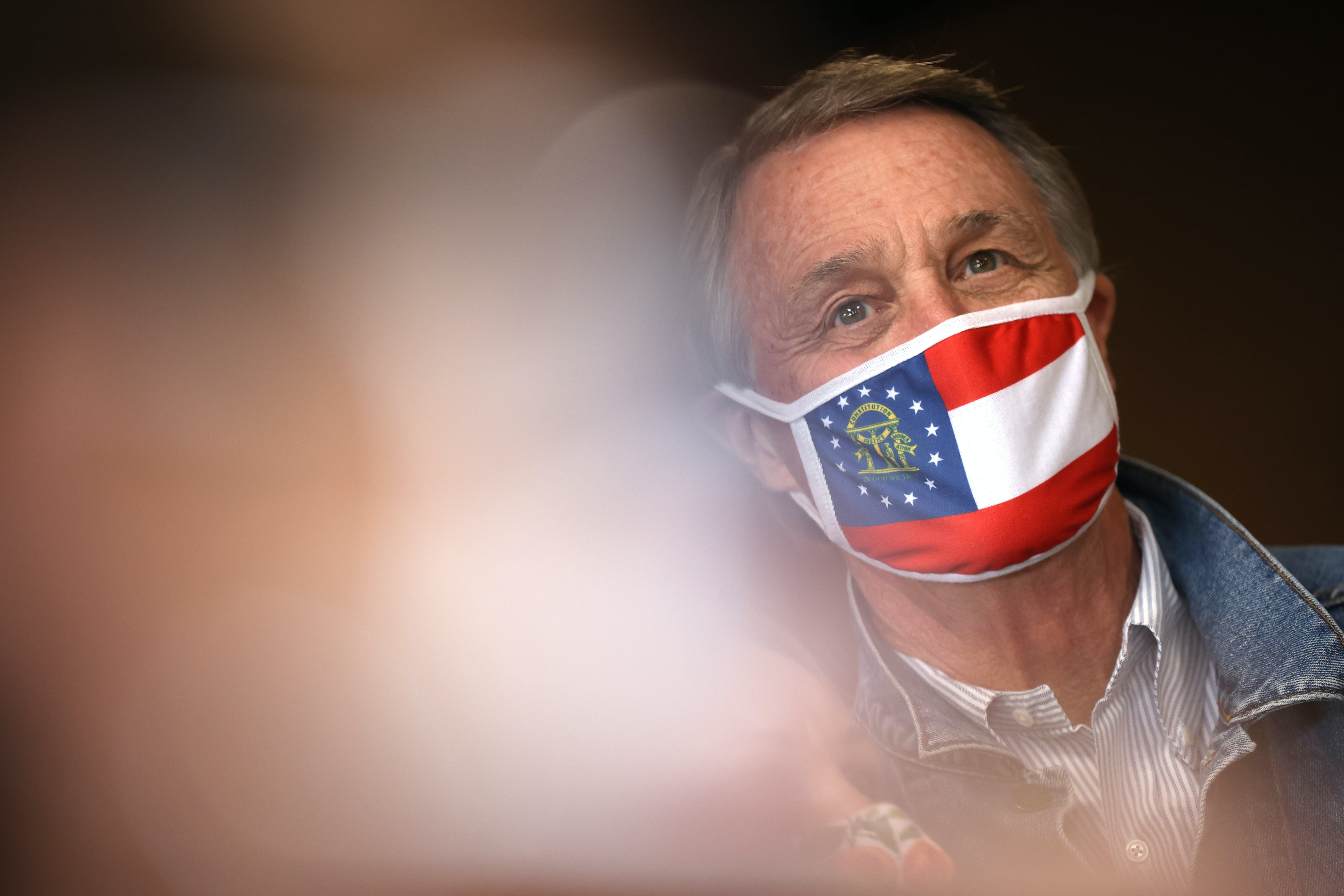 Republican senate candidate U.S. Sen. David Perdue (R-GA) looks on during a campaign event at Pot Luck Cafe on October 31, 2020 in Monroe, Georgia.
