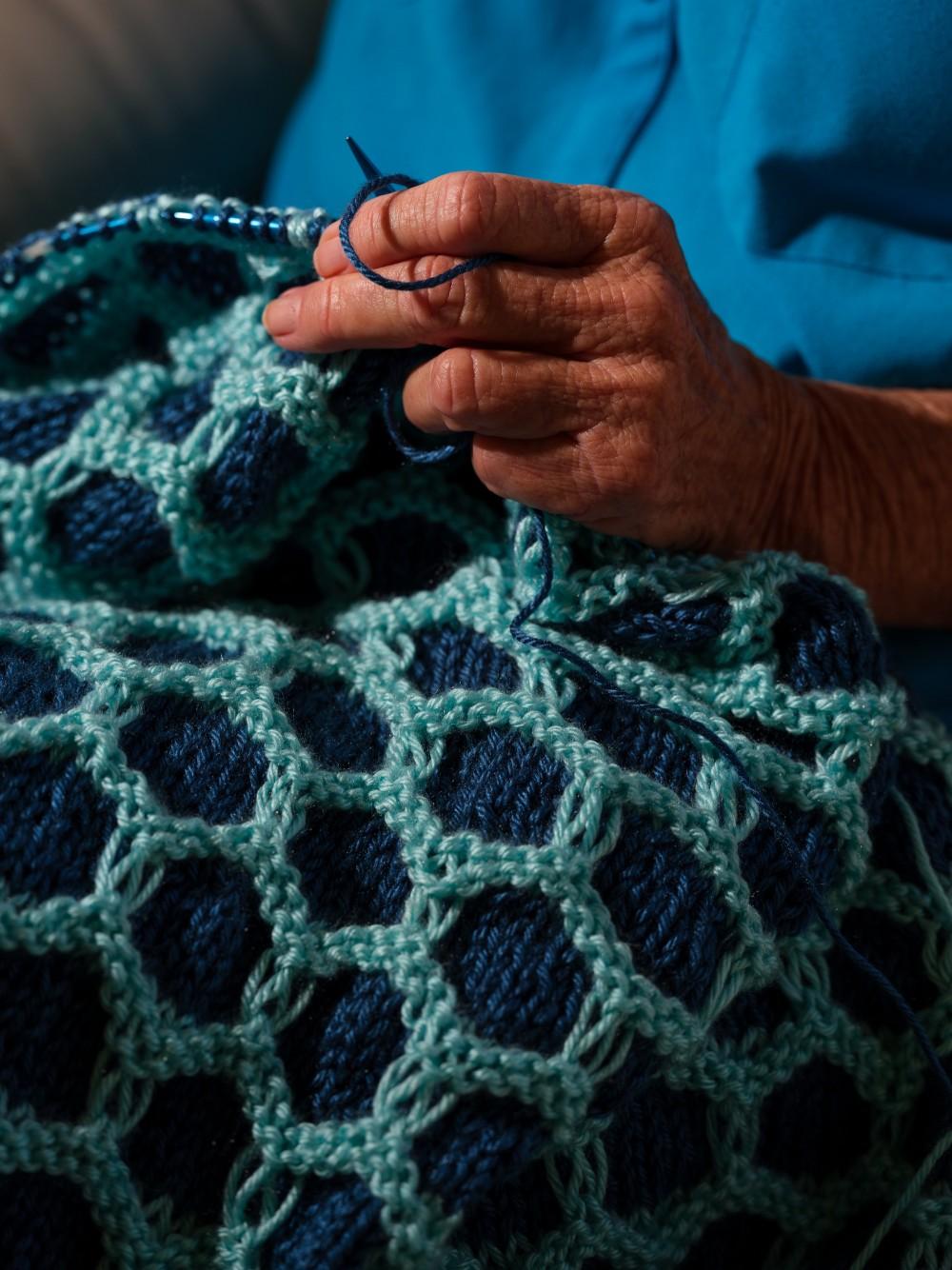 Jane Dorotik works on a blanket she is knitting, October 8, 2020.