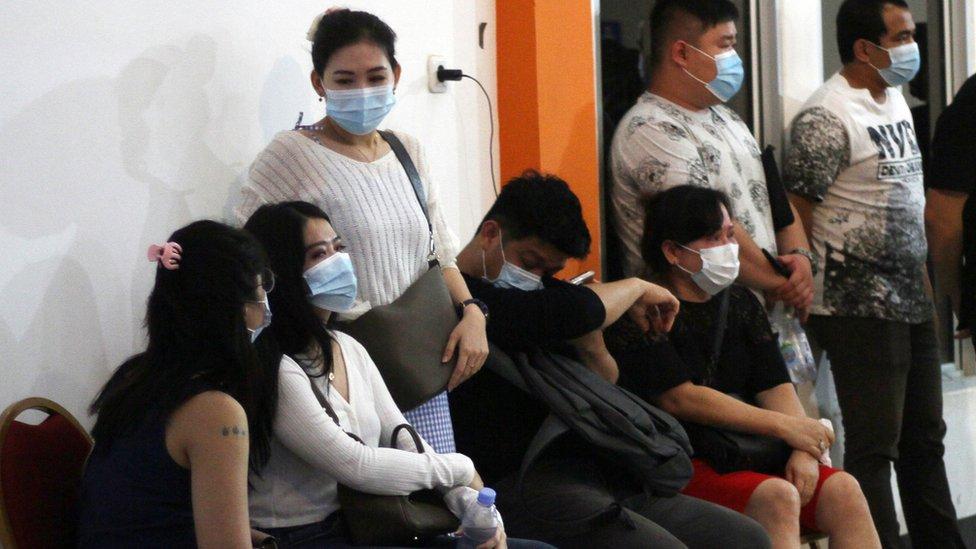 Family members of Sriwijaya Air plane passengers wait for news at Pontianak airport, Indonesia 9 January 2021